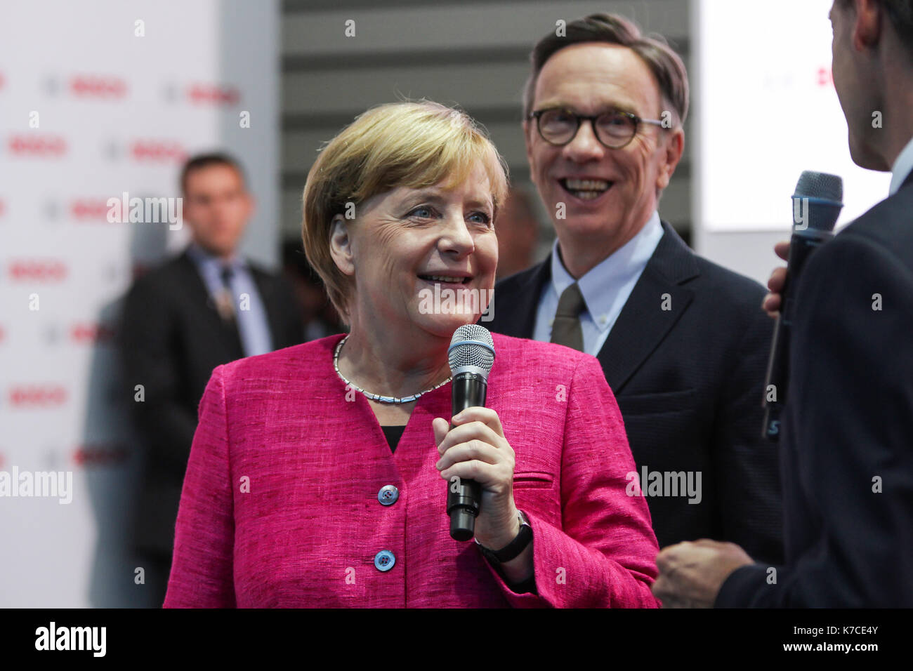 Frankfurt, Germany. 14th September, 2017. International Motor Show 2017 (IAA, Internationale Automobil-Ausstellung), opening walk with Angela Merkel, chancellor of Germany. here: Angela Merkel, Matthias Wissmann (president of German Association of the Automotive Industry, VDA, Verband der Automobilindustrie). Credit: Christian Lademann - Stock Image
