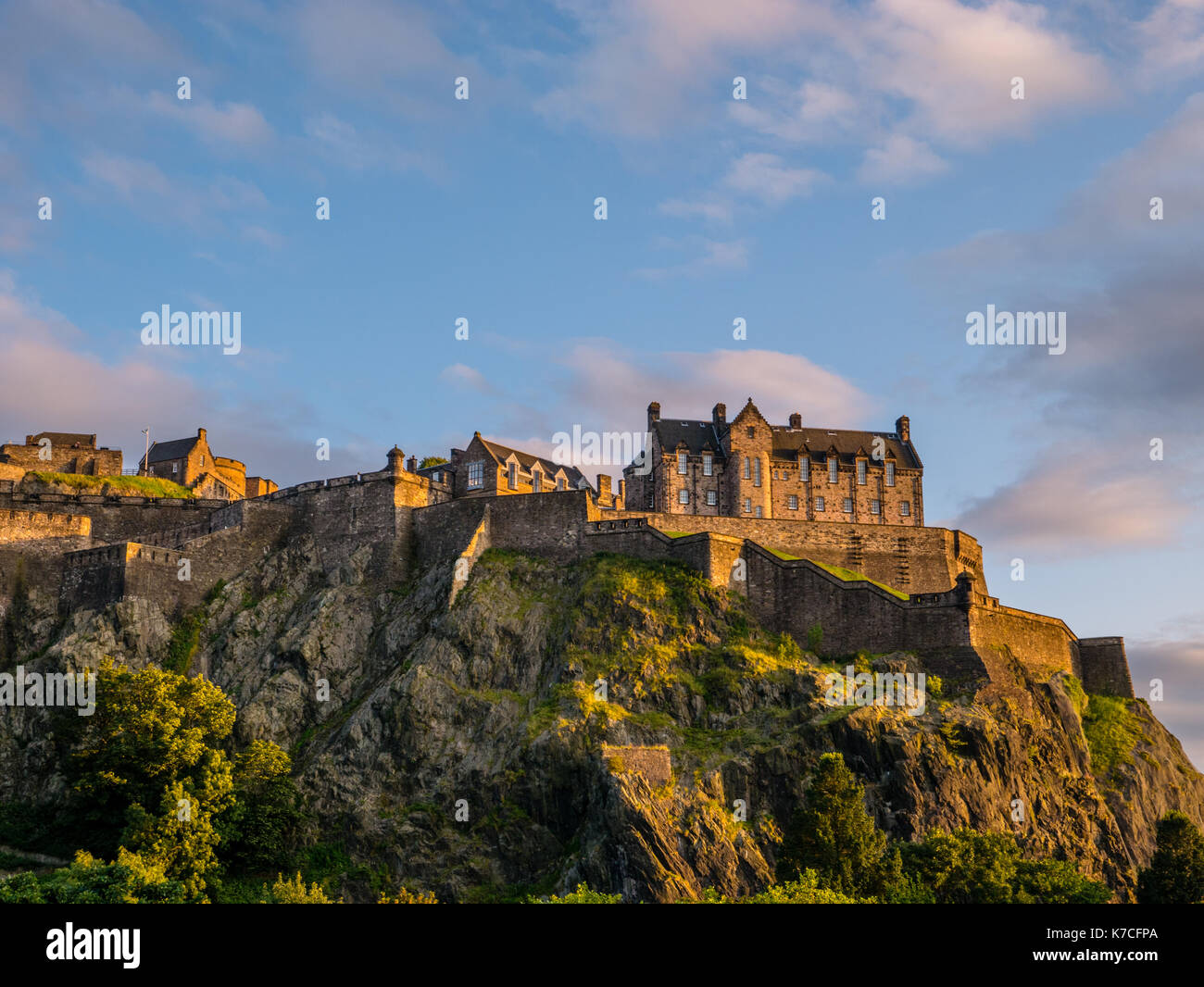 Sunset, Edinburgh Castle, viewed from Princes Street Gardens, Edinburgh Castle, Castle Rock, Edinburgh, Scotland. - Stock Image