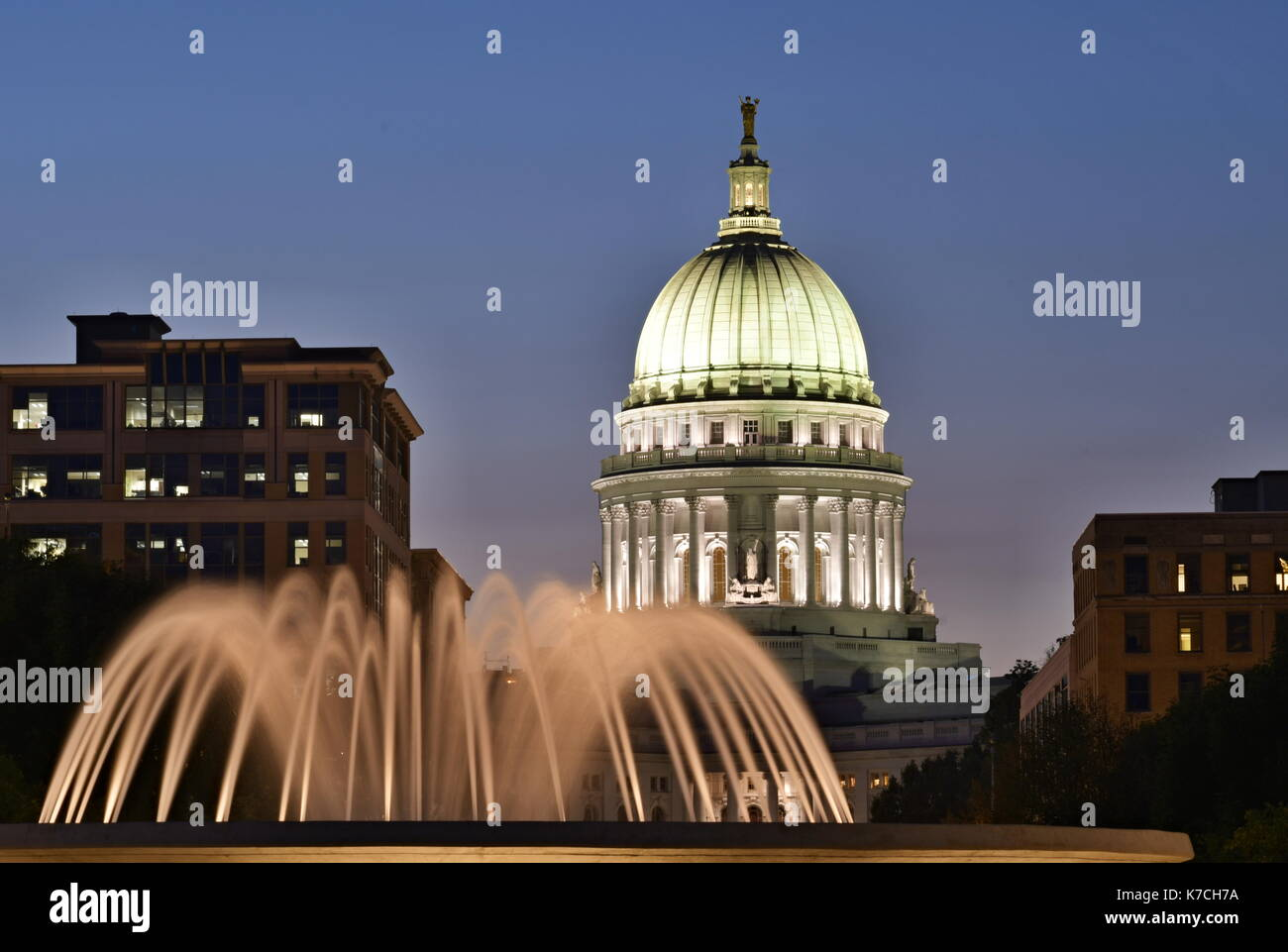 SEPTEMBER 12, 2017 - MADISON, WISCONSIN : The capital building dome in Madison, Wisconsin at night with the fountain Stock Photo