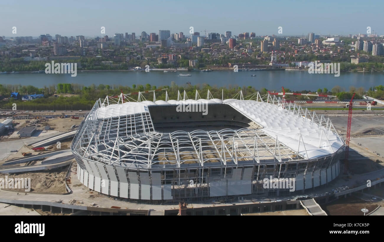 Aerial view on construction and reconstruction of football stadium. Reconstruction of stadium to host matches of world football championship in 2018. Russia. Construction company builds a stadium. Working Cranes - Stock Image