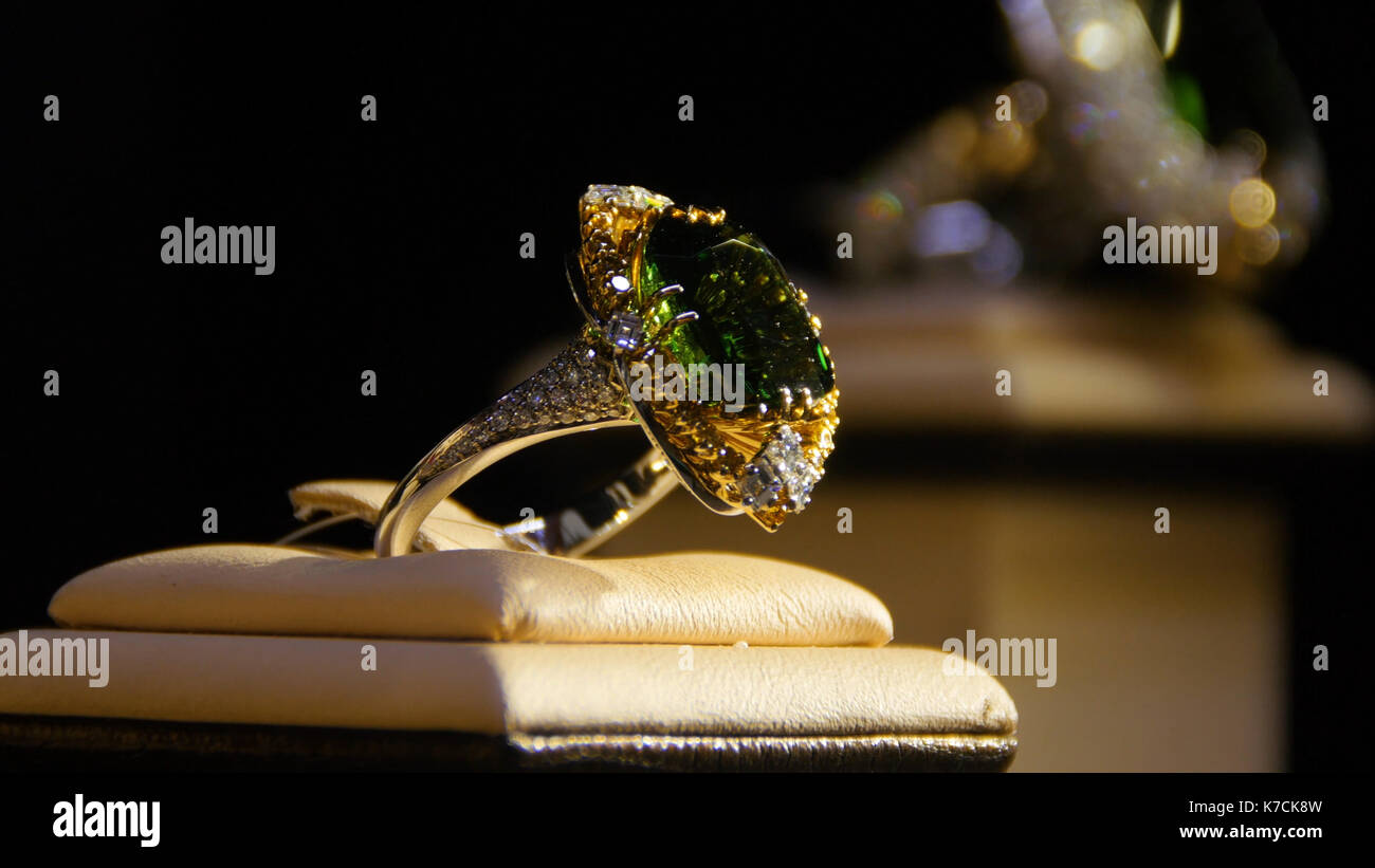 Jewelry with emeralds and diamond. Gemstones. Gold ring with emerald - Stock Image