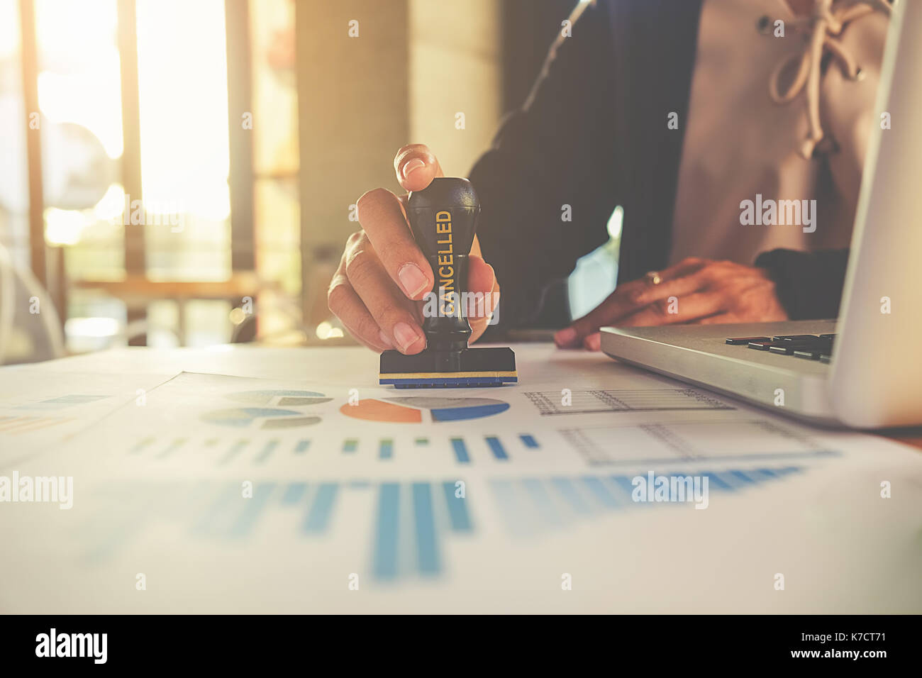 Business concept. Business people Hand Holding Rubber Stamp Over cancelled Stamp On datum. - Stock Image