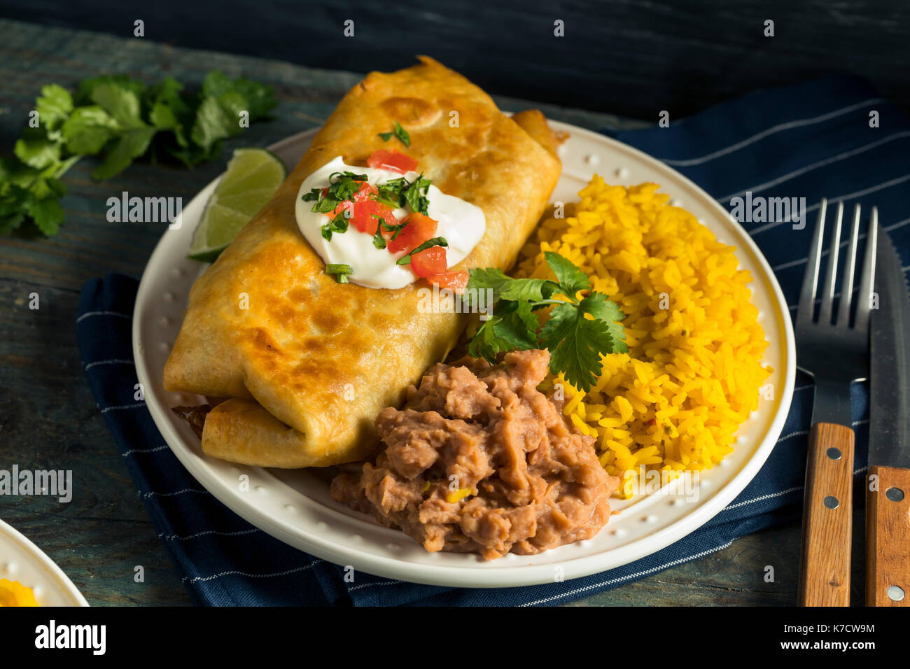 Deep Fried Beef Chimichanga Burrito with Rice and Beans - Stock Image