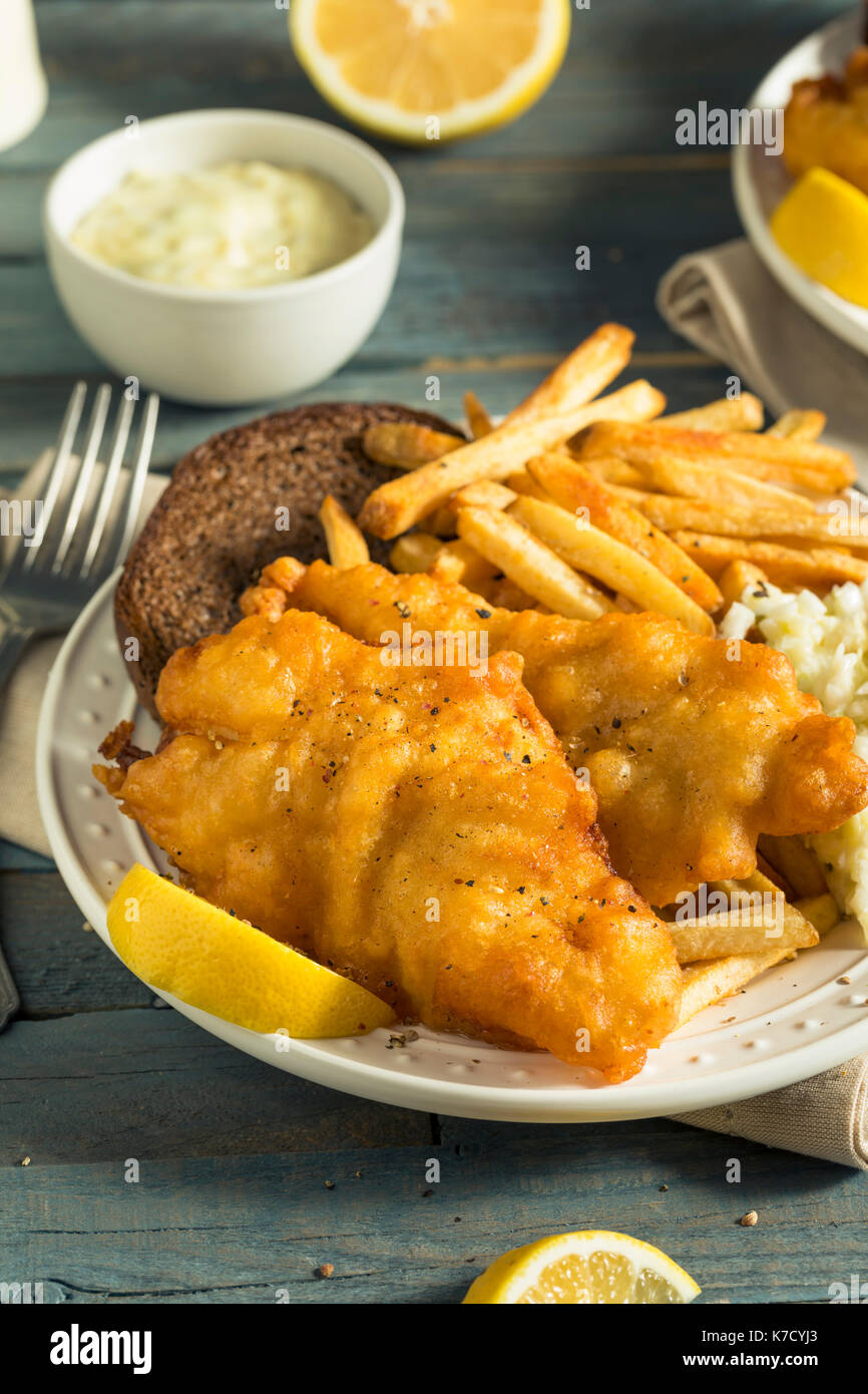 Homemade Beer Battered Fish Fry with Coleslaw and Chips - Stock Image