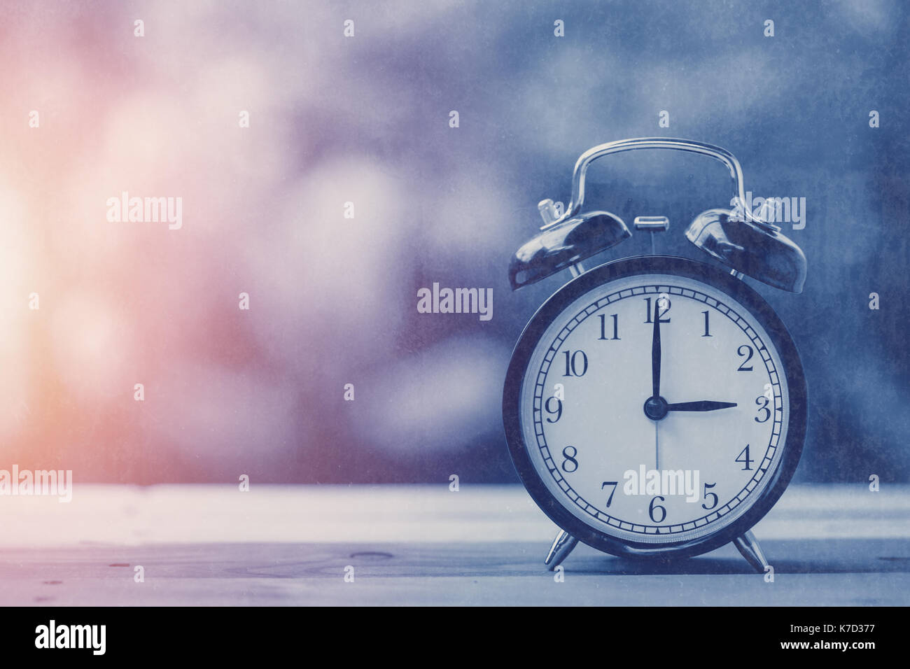 3 o'clock old retro clock blue vintage color tone with old grungy texture overlay - Stock Image