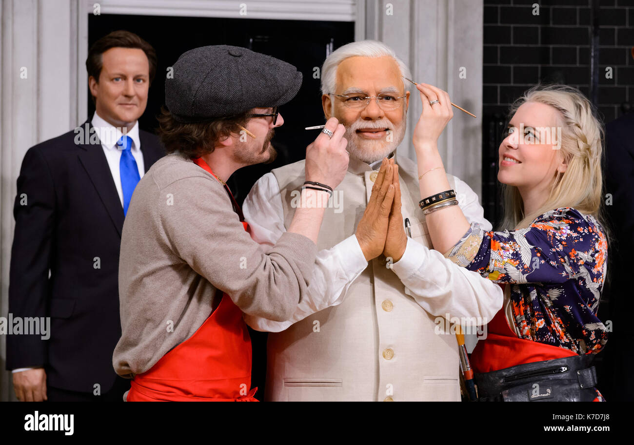 Photo Must Be Credited ©Alpha Press 065630 28/04/2016 Indian Prime Minister, Narendra Modi, this morning took his place alongside other world leaders at Madame Tussaud's London. His new wax figure today arrived at the Baker Street attraction fresh from Delhi, where Mr Modi had a private viewing with his likeness last week.  Madame Tussauds studio artist, Rebecca Ozkural and Chris Gargiulo put the finishing touches to the figure. - Stock Image