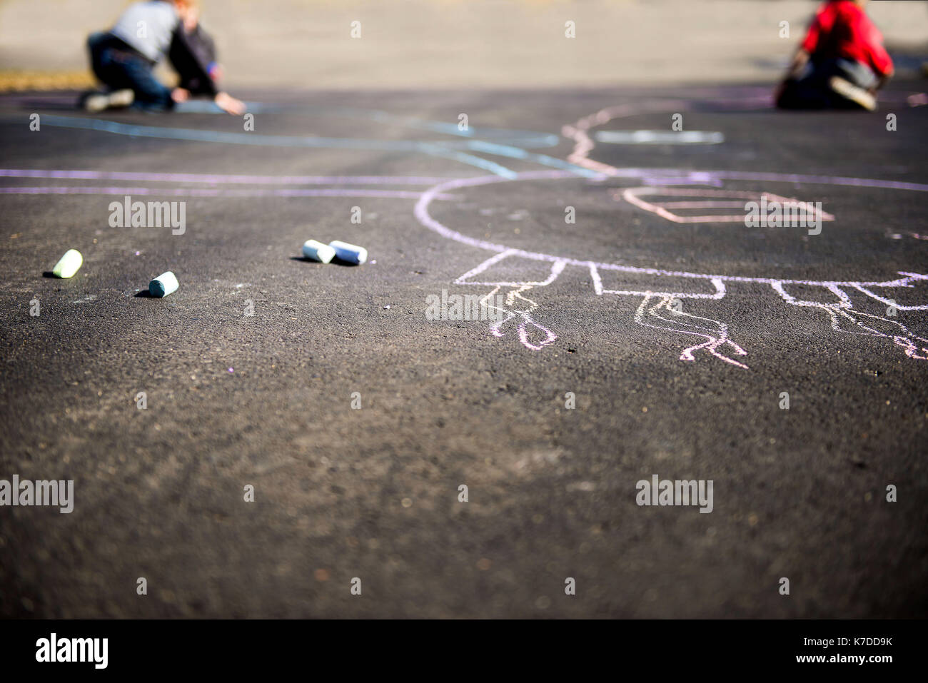 High angle view of chalk drawing on street - Stock Image