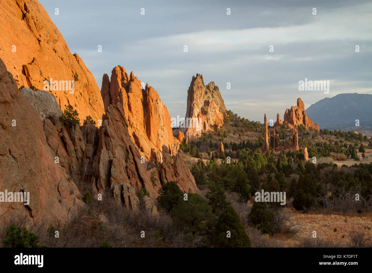 Rock formations at Garden of the Gods against cloudy sky during sunset - Stock Image
