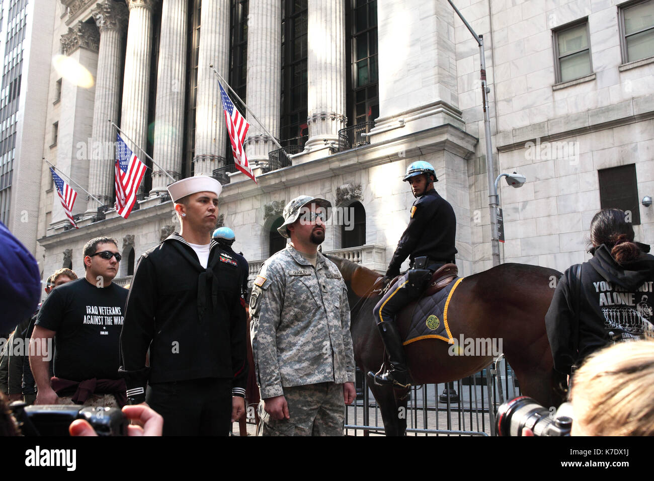 Veterans of the U.S. military march in front of the New York Stock Exchange toward Zuccotti Park in New York on Stock Photo