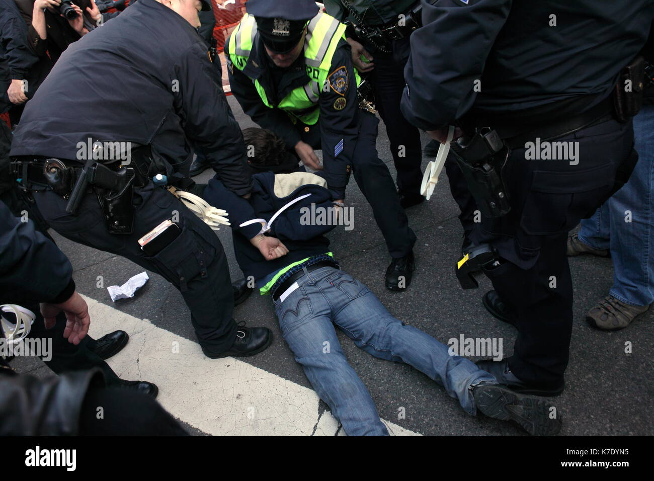 NYPD officers arrest a young an as he refuses to vacate the sidewalk outside the New York County Supreme Court at Foley Square on November 5, 2011. Pr - Stock Image