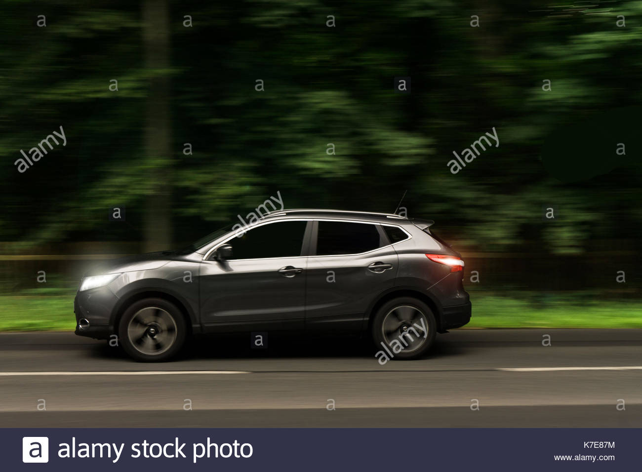 Nissan Qashqai on Country Road - Stock Image