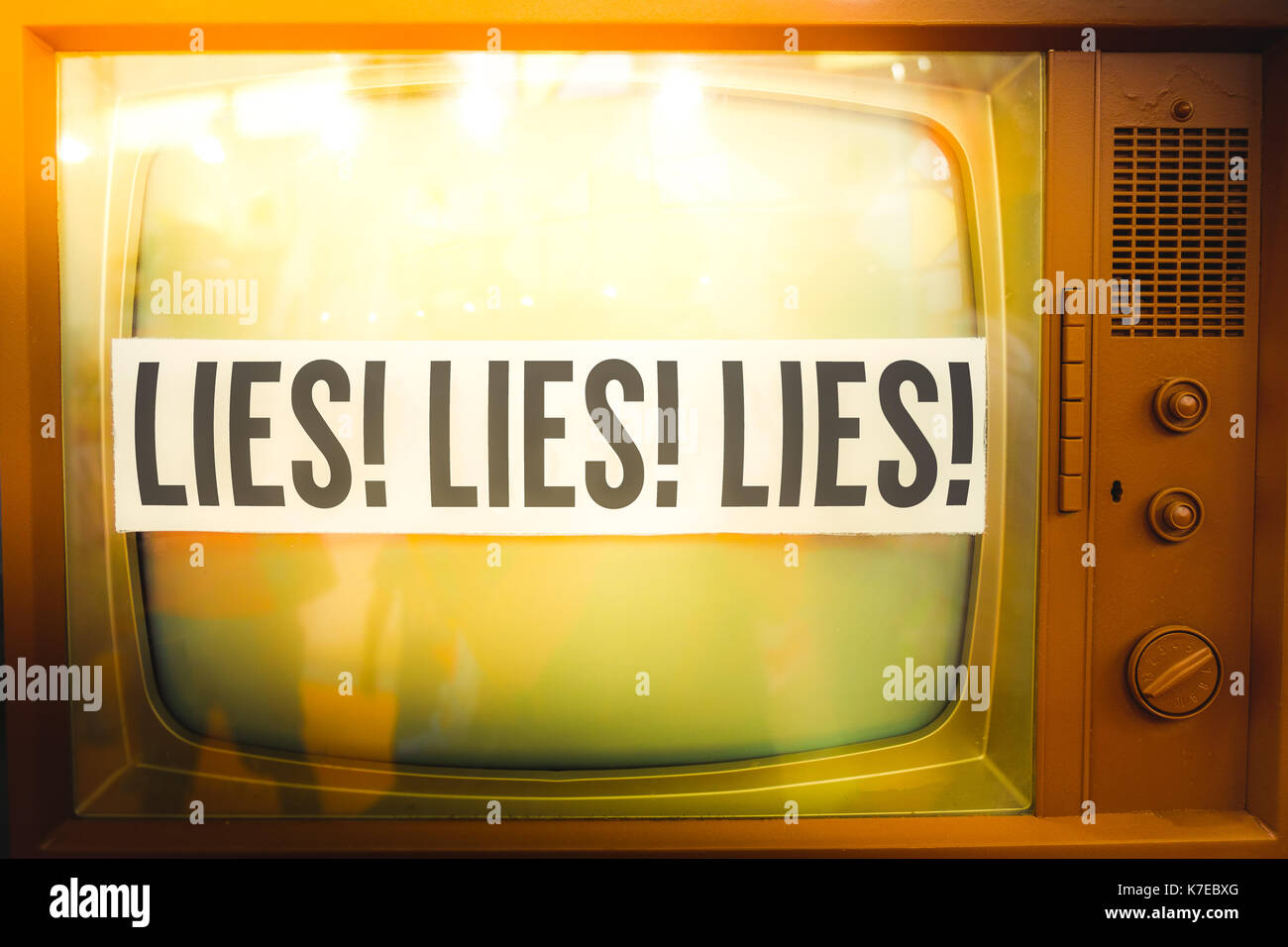 lies of mainstream media propaganda disinformation old tv label vintage - Stock Image