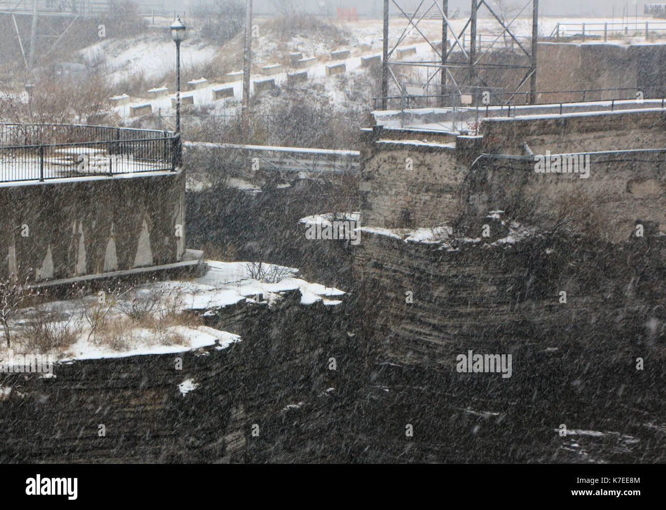 Rock-cut channels at hydro facility on a dark winter day in Ottawa, Canada. - Stock Image