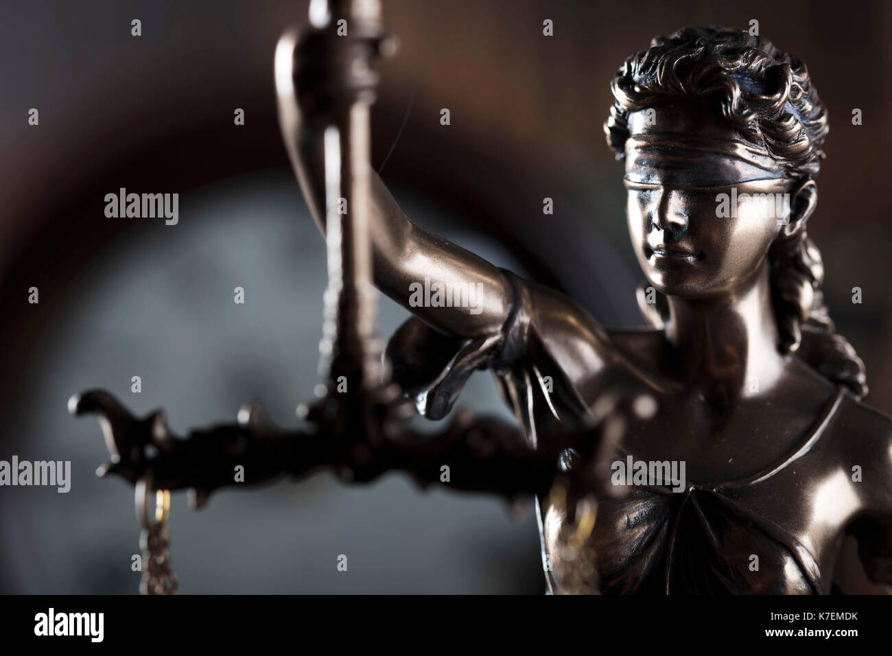 Old library. Vintage clock. Statue of justice and gavel. Law concept. - Stock Image