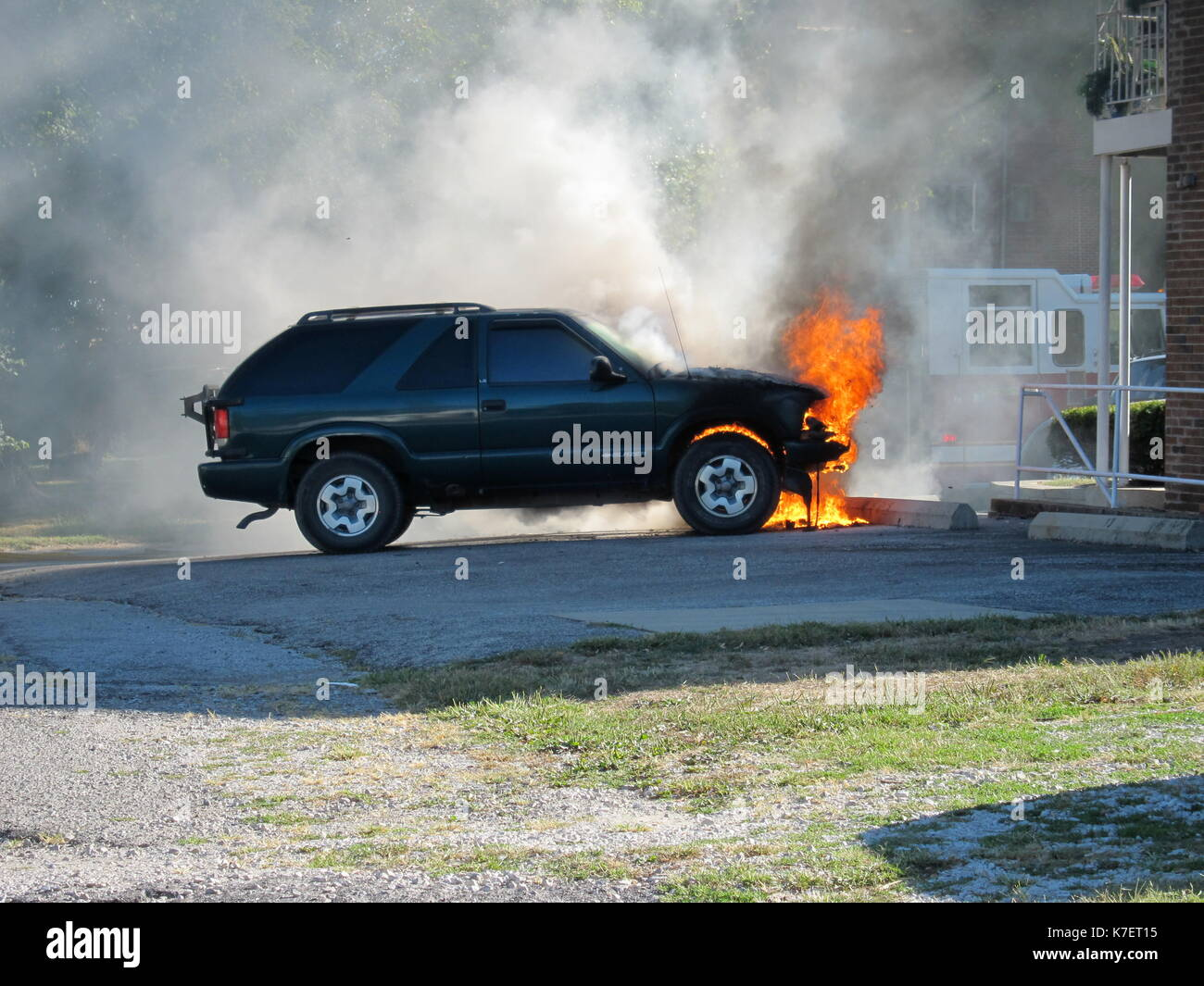 Car on fire - Stock Image