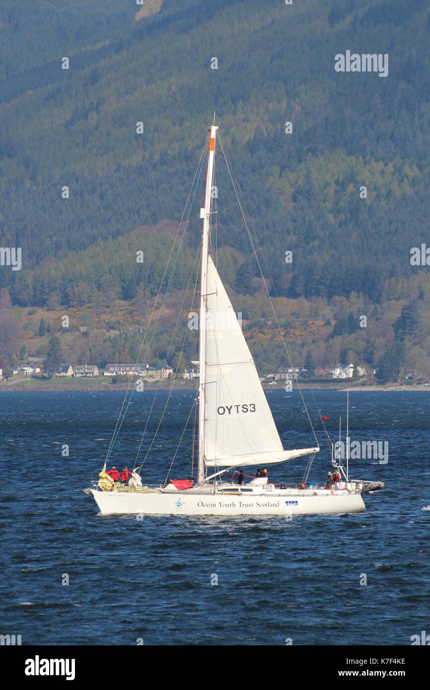 STV Alba Explorer (OYTS3), a sail training vessel operated by Ocean Youth Trust Scotland, off Cloch Point on the Firth of Clyde. - Stock Image