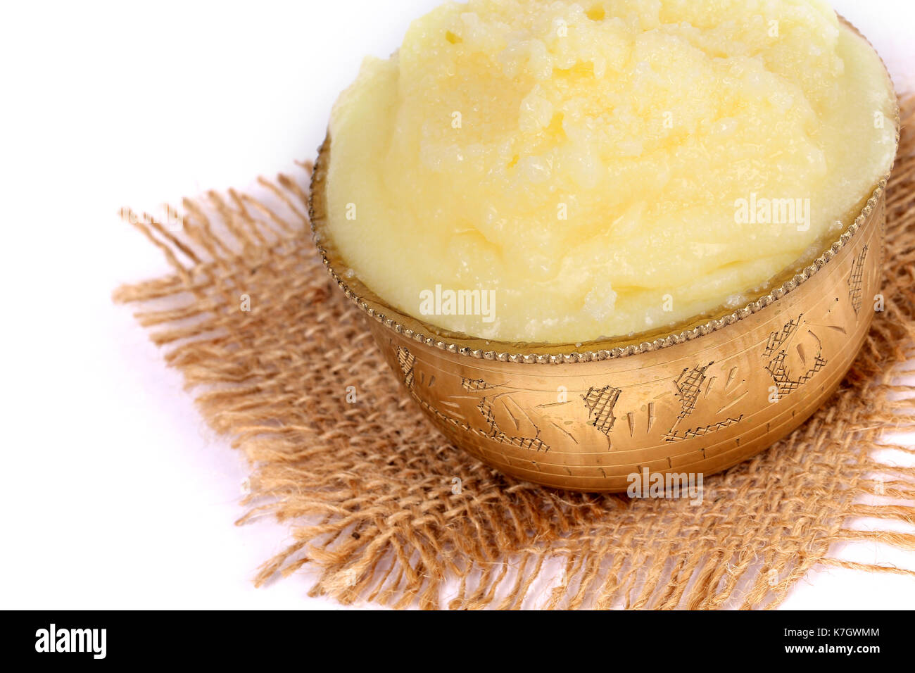 Desi ghee or clariified liquid butter, cooking oil, pure ghee - Stock Image