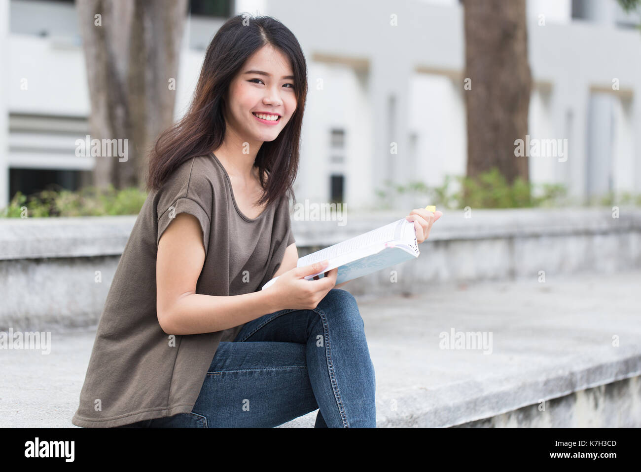 Asian Teen Women Reading Book Happiness And Smile Enjoy Education In University Stock Image