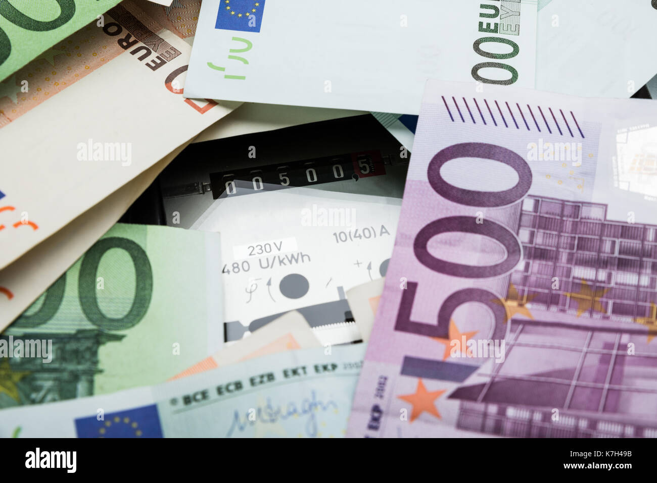 Close-up Of A Euro Banknotes Over Electricity Meter - Stock Image