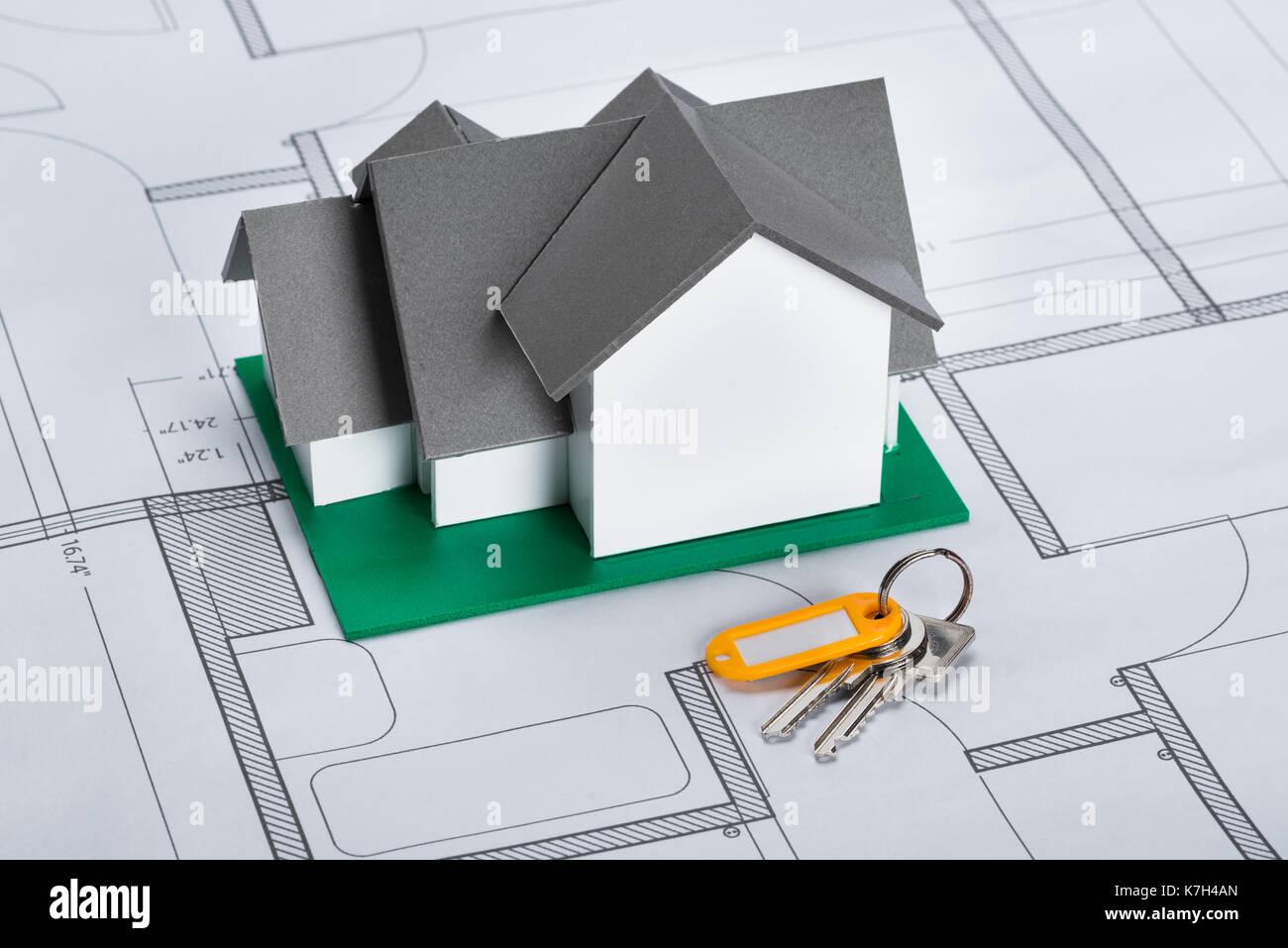 Close up of house model with keys on blueprint stock photo close up of house model with keys on blueprint malvernweather Choice Image