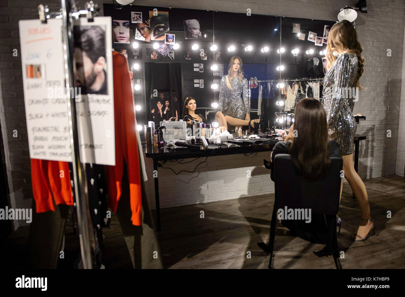 Photo Must Be Credited ©Alpha Press 065630 07/02/2016 Cara Delevingne looks on as Kendall Jenner finalises her look for Fashion Week at Madame Tussauds London. Madame Tussauds London gave 100 fashionistas a special preview of its new behind-the-scenes fashion experience this weekend, before opening to the public today. The new addition to the World famous attraction offers guests a peek backstage at an international fashion event brought to life through a multisensory set, plus fans get to hang out with two of the fashion world's most famous faces, Kendall Jenner and Cara Delevingne (plus a gu - Stock Image