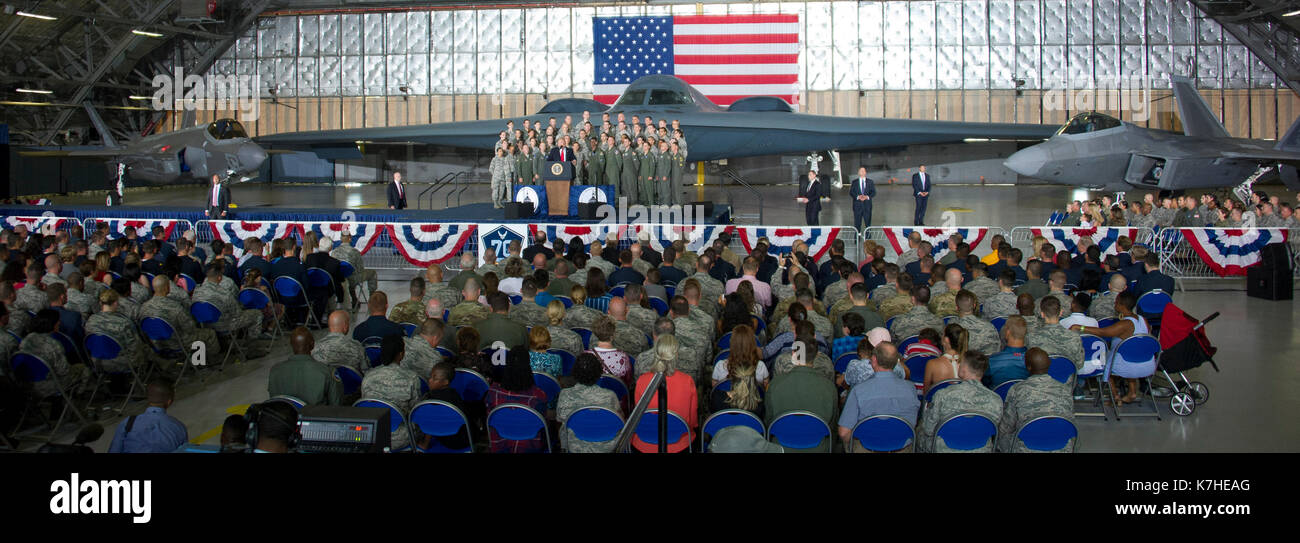 United States President Donald J. Trump delivers remarks to military personnel and families in a hanger at Joint Base Andrews in Maryland on Friday, September 15, 2017. He visited JBA to commemorate the 70th anniversary of the US Air Force. In the background behind the group, from left is a F-35 Joint Strike Fighter, a B-2 Stealth Bomber and a F-22 fighter. Credit: Ron Sachs/CNP - Stock Image