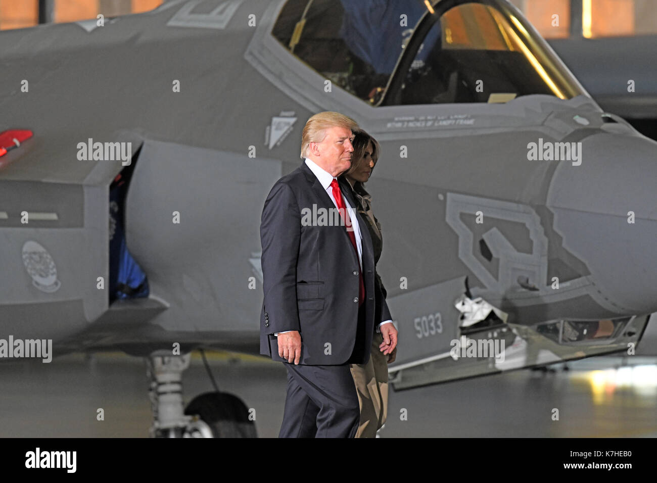 United States President Donald J. Trump and first lady Melania Trump walk in front of an F-35 Joint Strike Fighter as they arrive for the President to deliver remarks to military personnel and families in a hanger at Joint Base Andrews in Maryland on Friday, September 15, 2017. The F-35 is a plane the President has criticized in the past. He visited JBA to commemorate the 70th anniversary of the US Air Force. Credit: Ron Sachs/CNP - Stock Image
