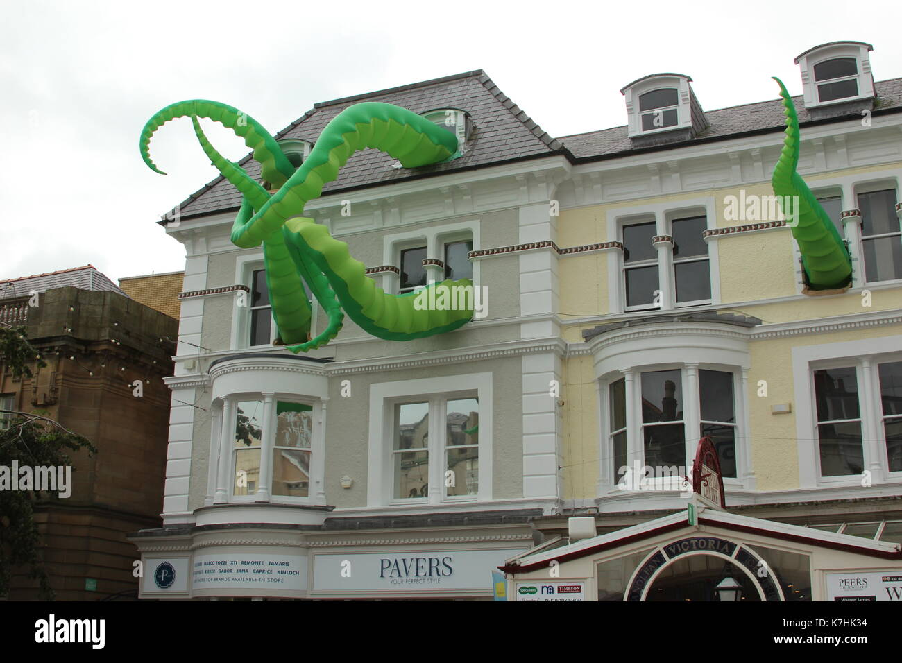 Llandudno,Wales,UK Saturday 16 September 2017  These green tentacles waving from the towns victoria shopping centre are art attacks, a work created by street artist filthy luker as part of the Llawn05 festival. Credit: Mike Clarke/Alamy Live News - Stock Image