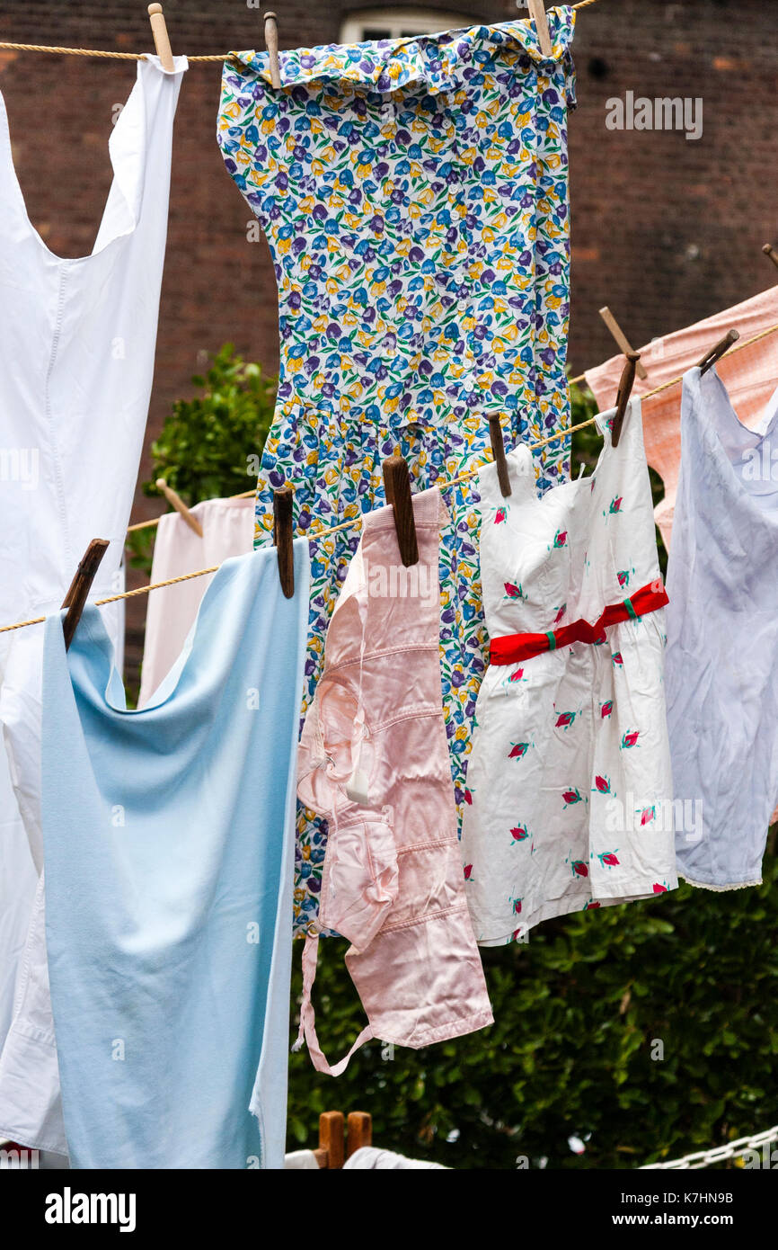 England. 1940's period Clothing hanging out to dry. Dresses and brassiere - Stock Image