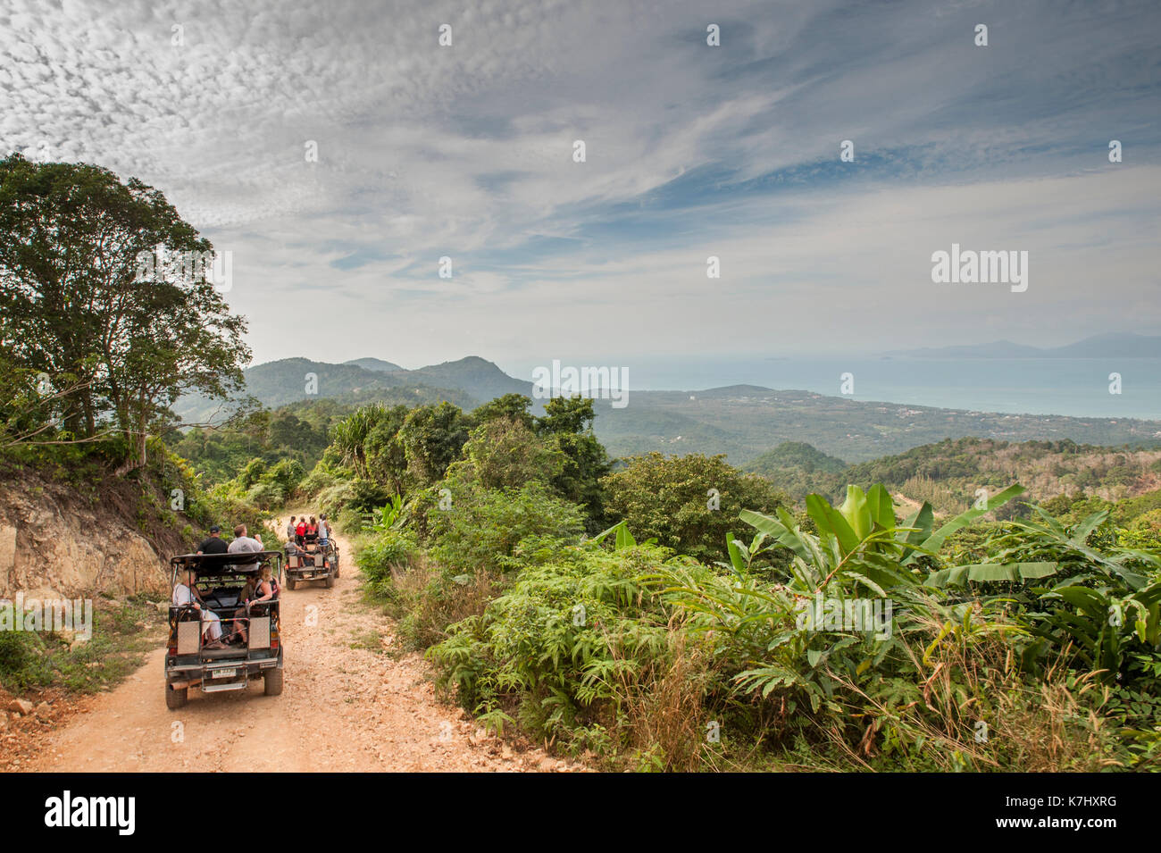 Jeeps full of tourists on the tracks through the island of Koh Samui, Thailand - Stock Image
