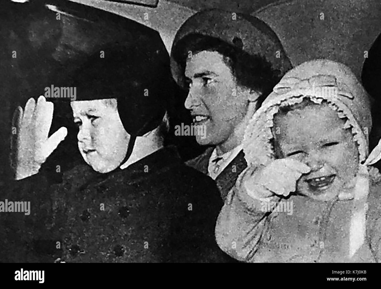 1950 - A magazine photograph showing prince Charles and Princess Anne, children of Queen Elizabeth II of Britain, accompanied by possibly their nanny at the time. - Stock Image