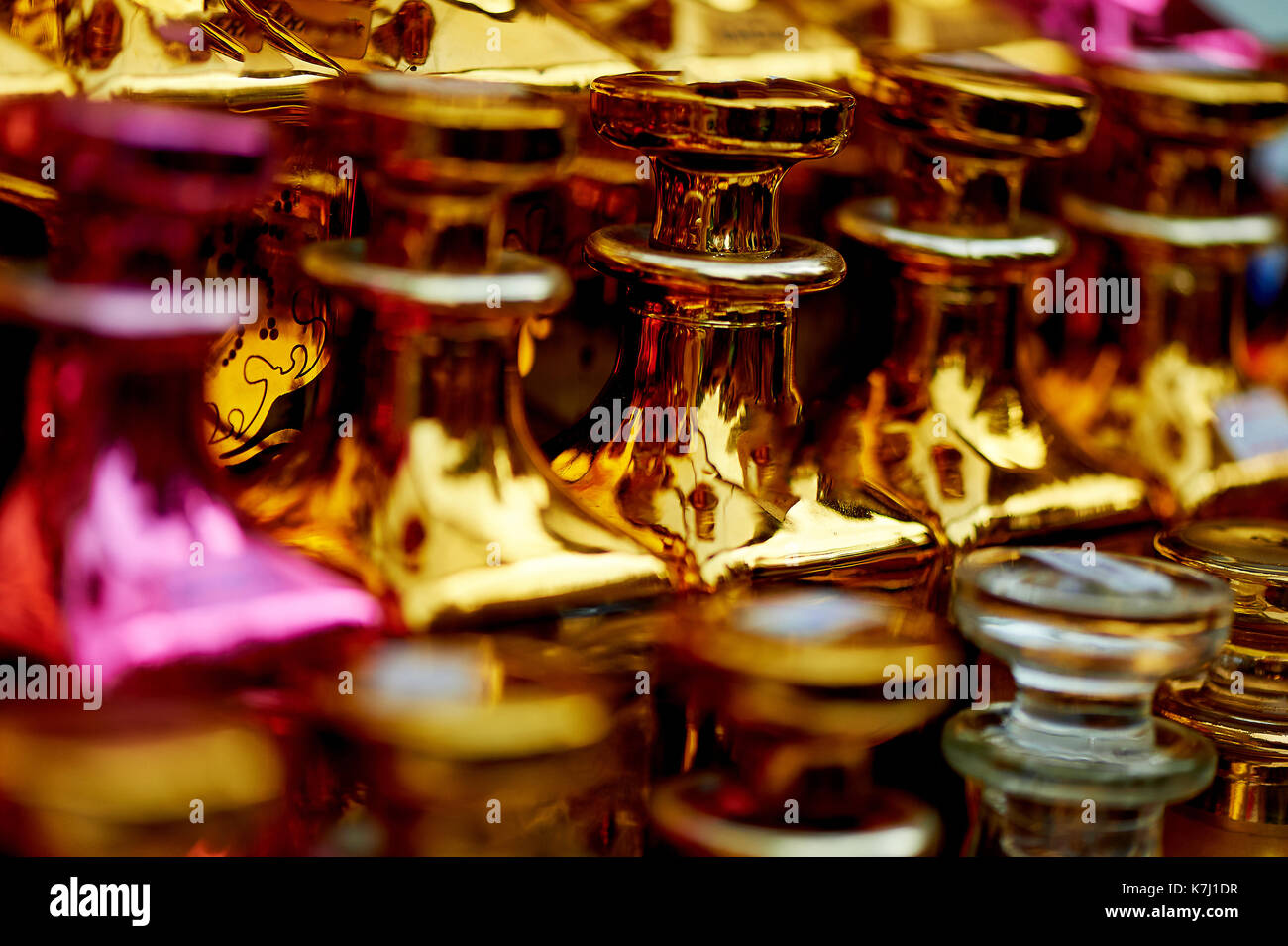 Glass perfume bottles based oils.A Bazaar, market. Macro. Gold and pink gamma - Stock Image