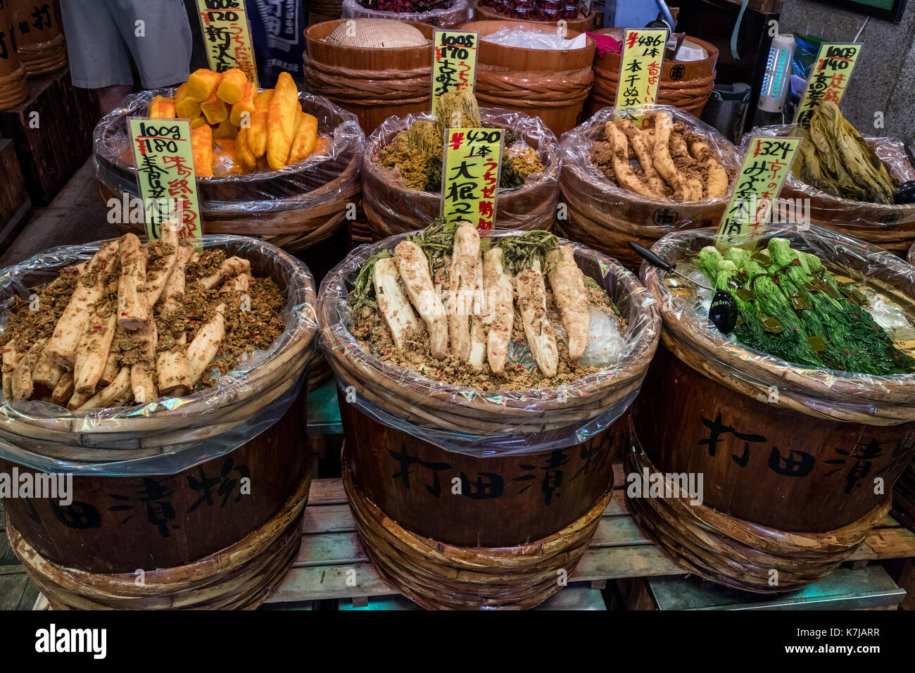 Kyoto, Japan -  May 17, 2017:Preserved vegetables, tsukemono, in wooden barrels for sale on the Nishiki market - Stock Image