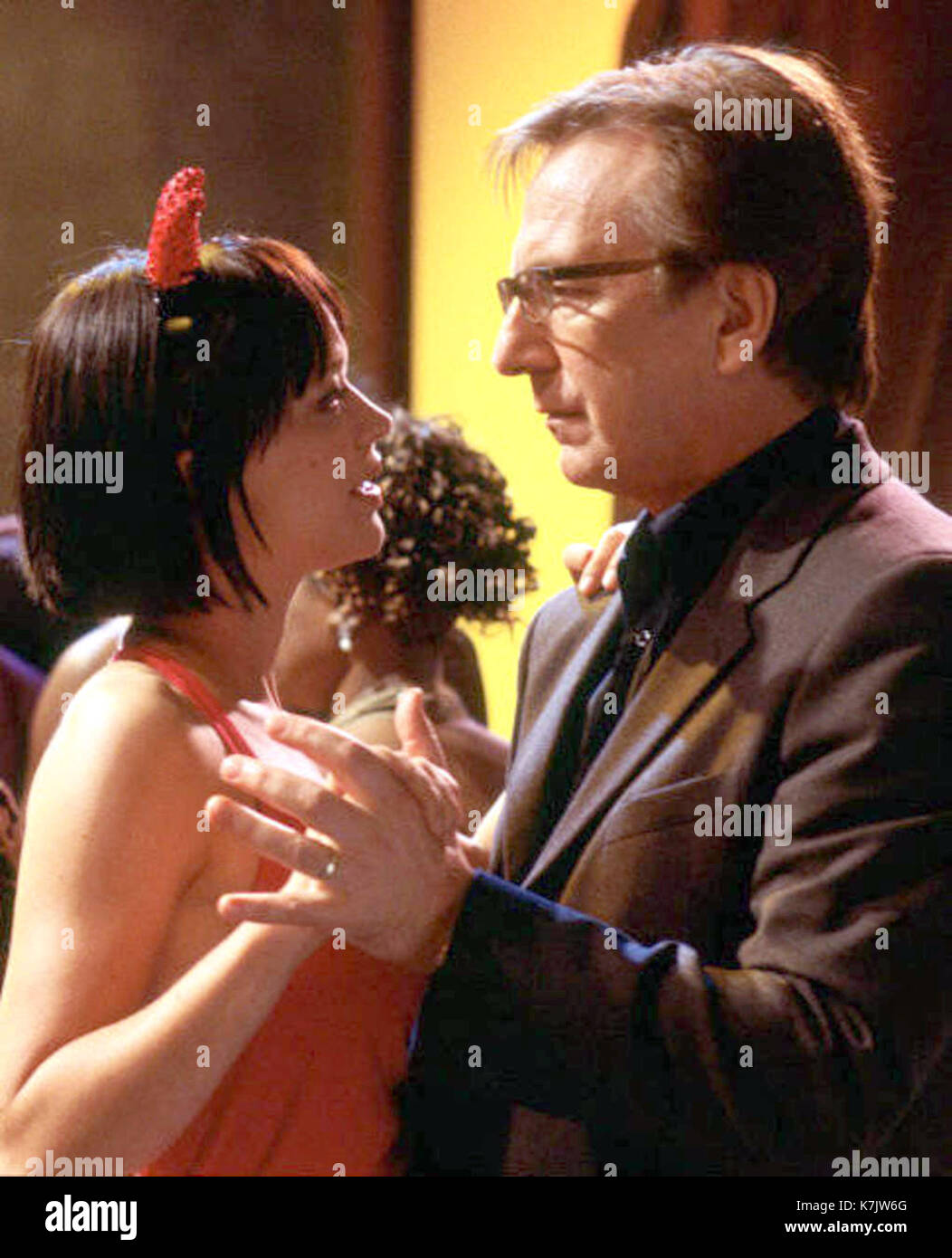 Photo Must Be Credited ©Supplied by Alpha 070000 (2003) Heike Makatsch as Mia and Alan Rickman as Harry in the movie Love Actually. - Stock Image
