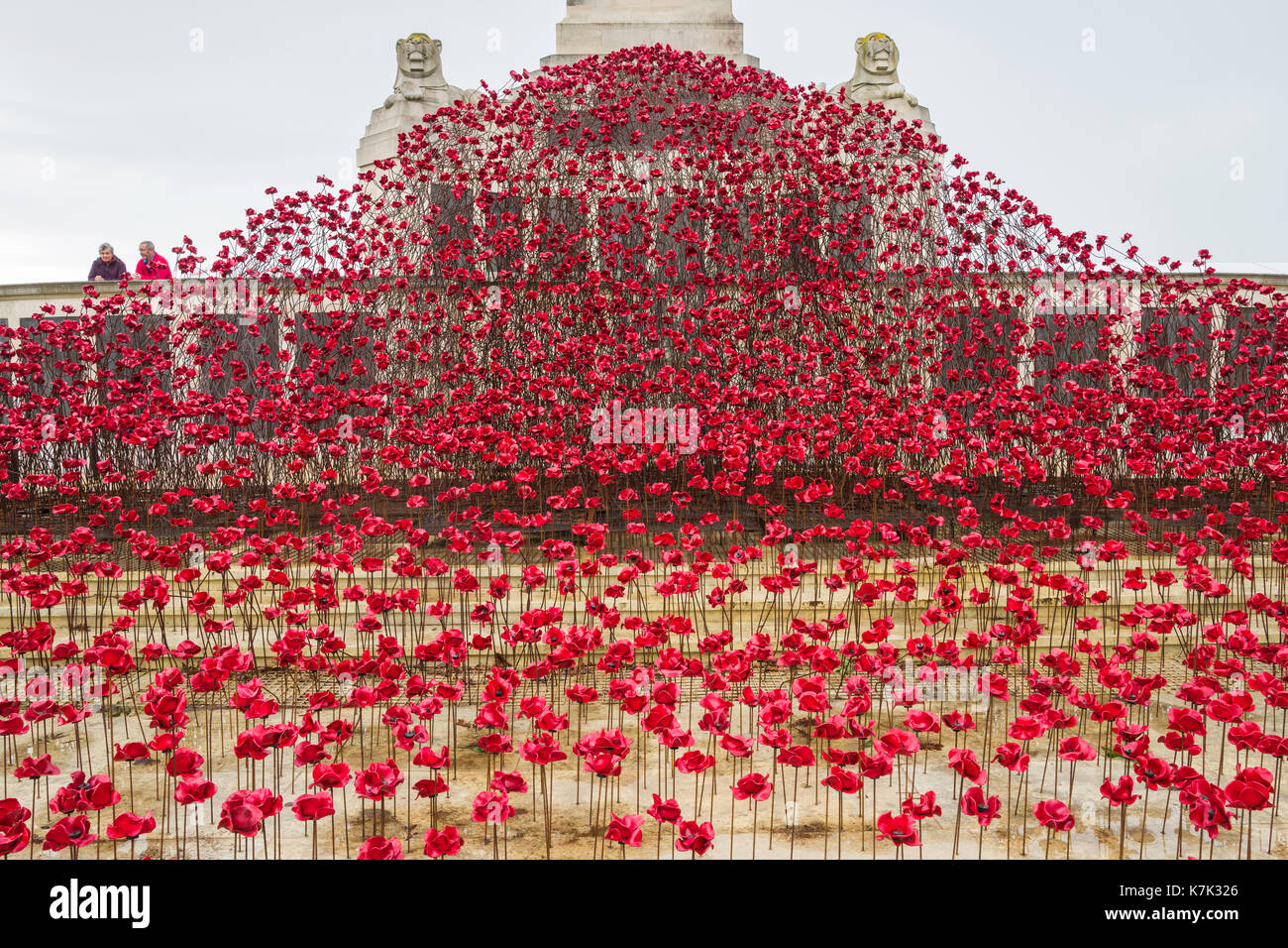POPPIES: WAVE, vibrant display of ceramic poppies at Plymouth Naval Memorial, Plymouth Hoe, UK.  By artist Paul Cummins and designer Tom Piper. - Stock Image