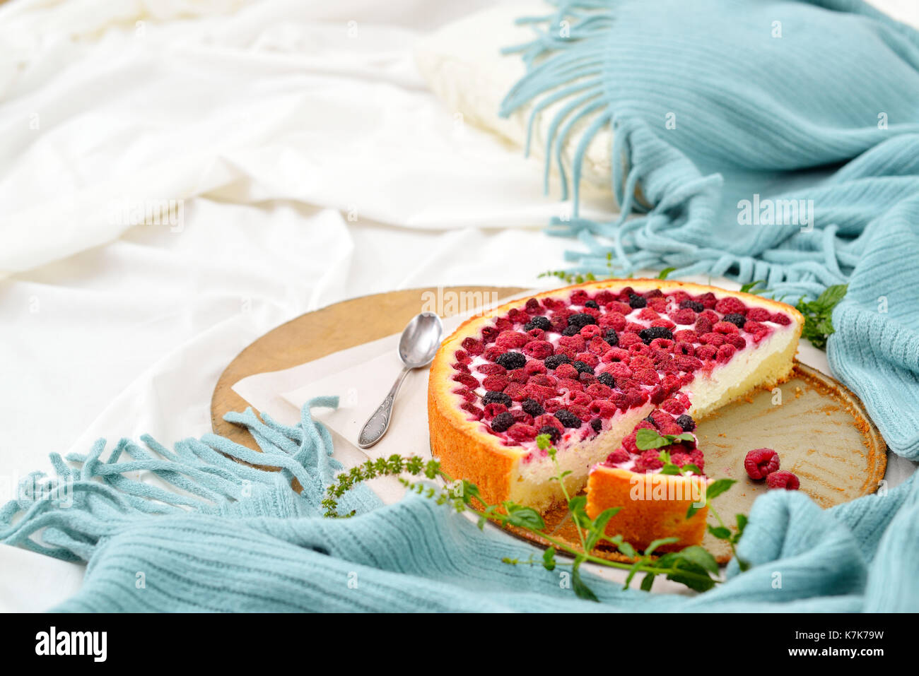 Flat lay breakfast in bed with raspberry cheesecake, mint tea . Window light, space for text blog, posts - Stock Image