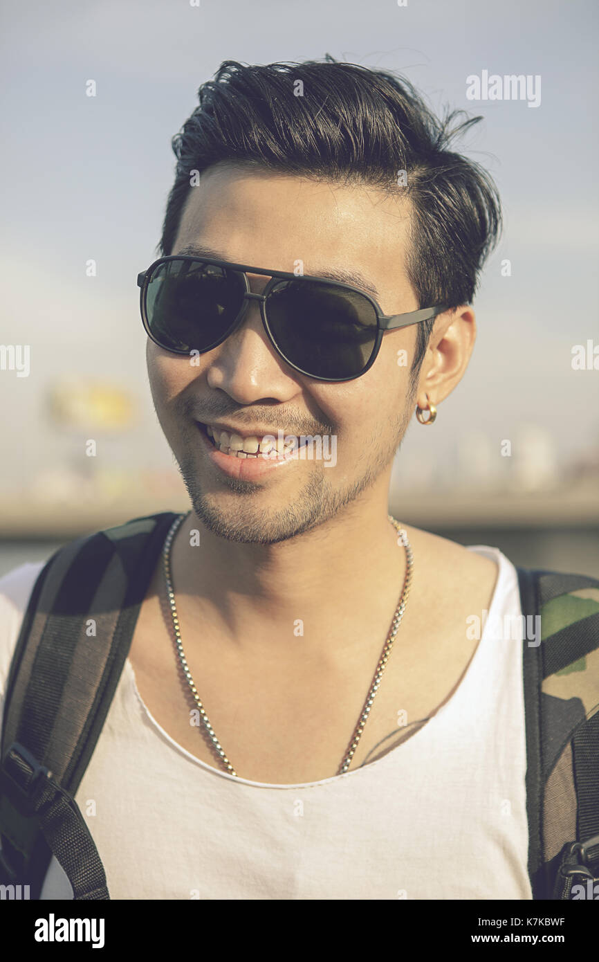 face of asian younger man toothy smiling face happiness emotion Stock Photo