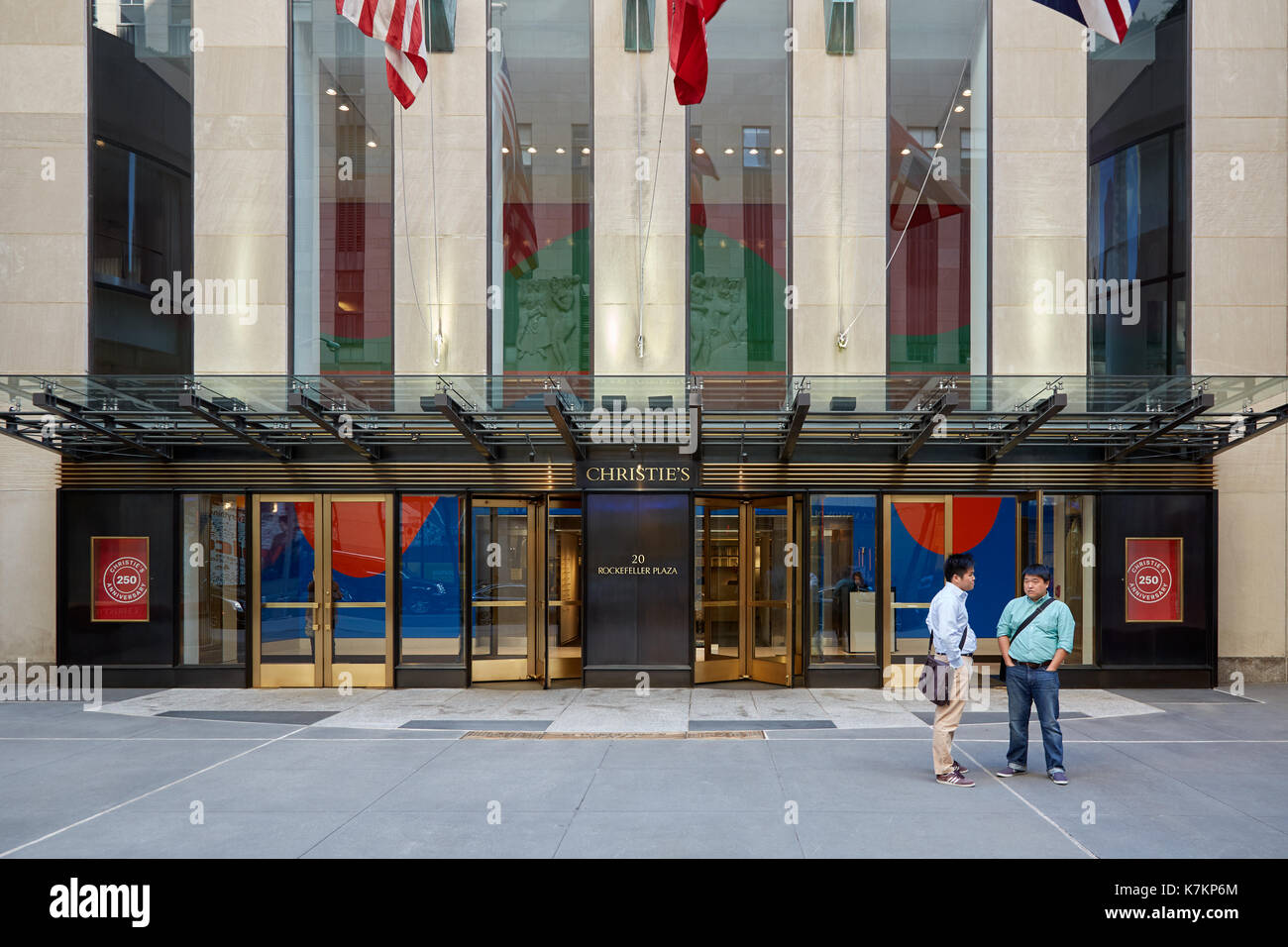 Christie's American branch entrance with people in Rockefeller Center in New York - Stock Image