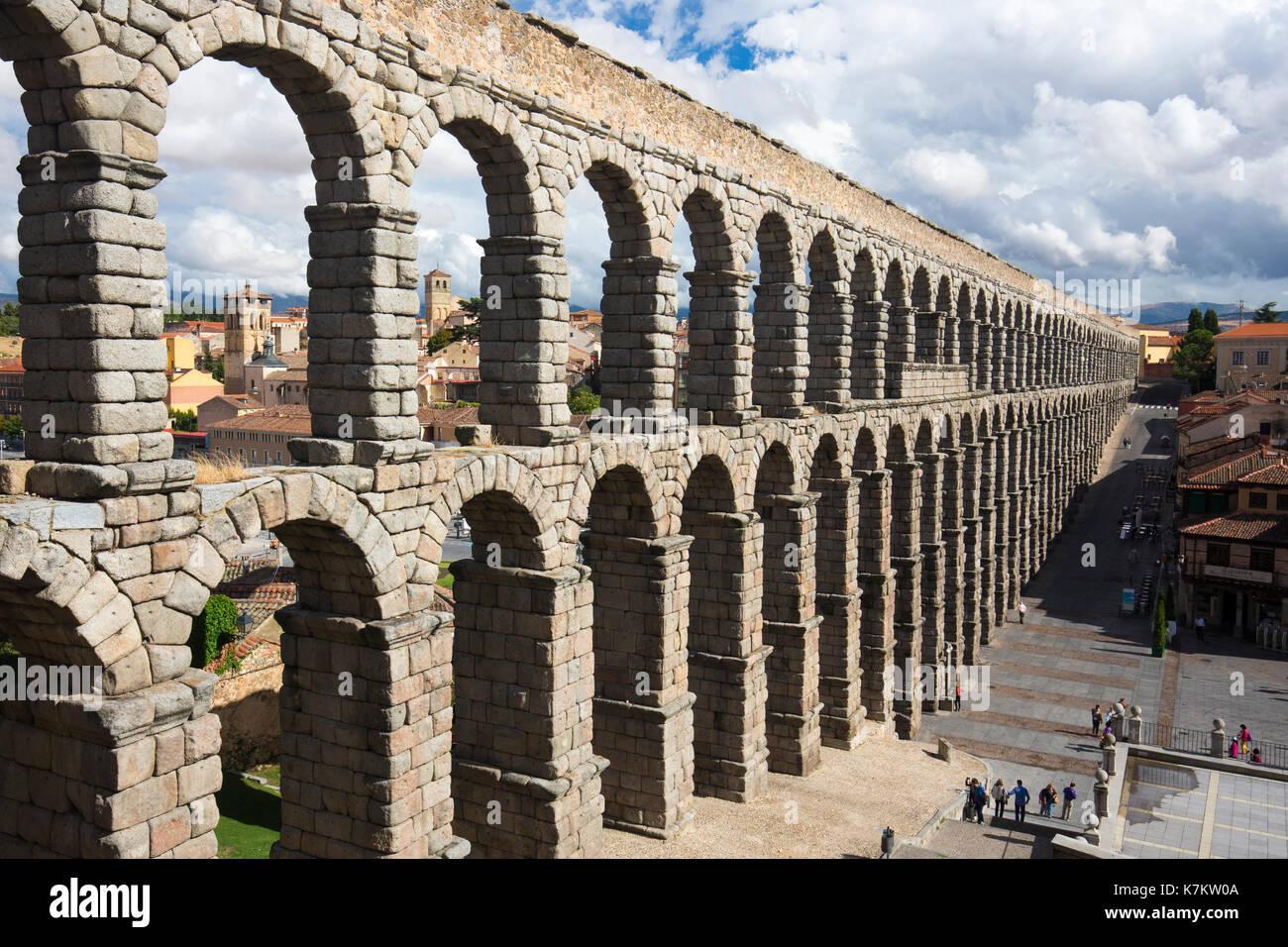Famous spectacular Roman aqueduct, built of granite blocks, and Plaza del Azoguejo, Segovia, Spain - Stock Image
