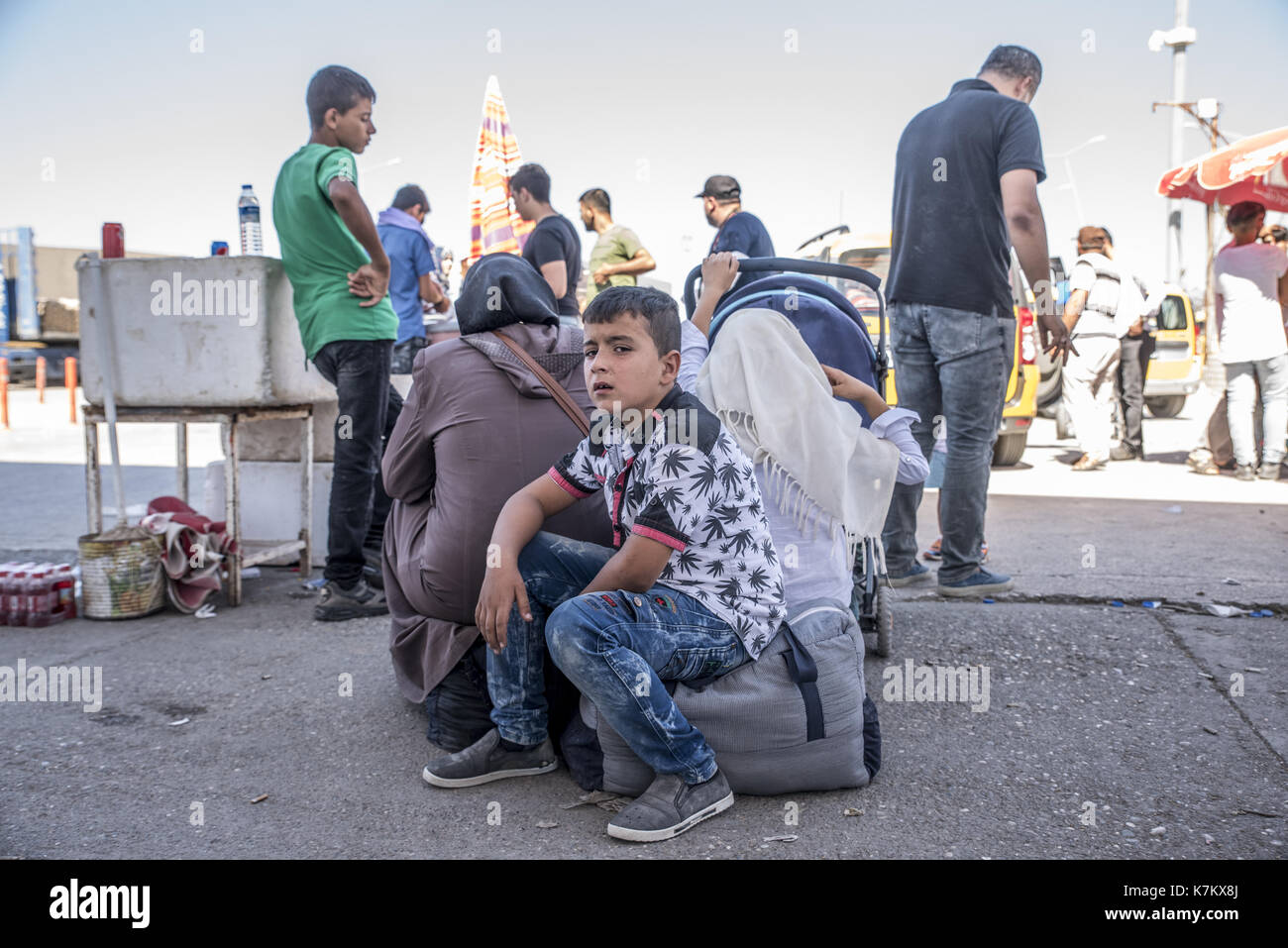 Syrian refugees (mainly from Aleppo and Idlib) entering Turkey in Kilis. Most of them will live in refugee camp. September 8, 2017; Kilis, Turkey. - Stock Image