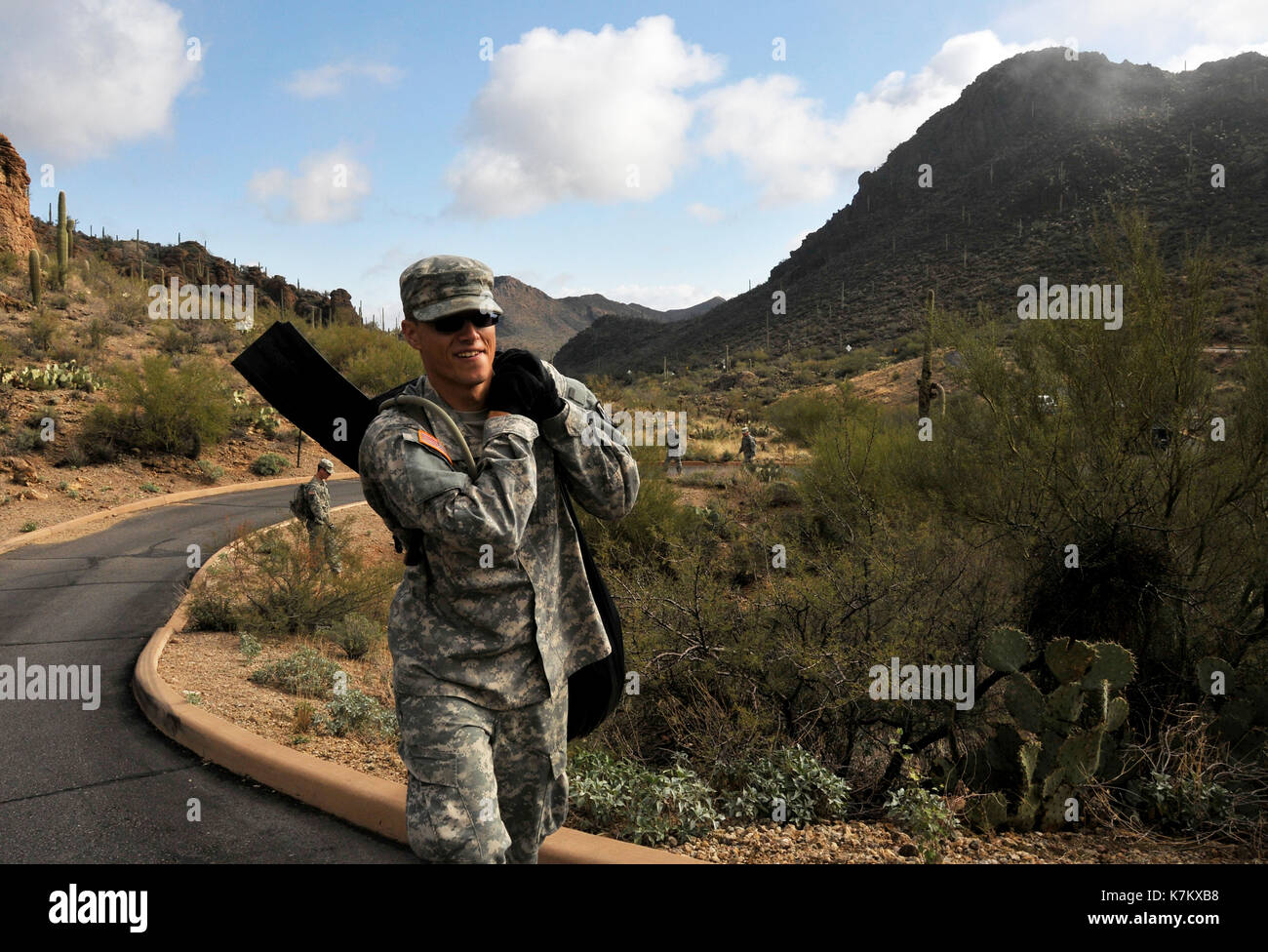 Members of the U S. Army National Guard, Alpha Company, 1st Battalion, 158th Infantry Regiment, 'Bushmasters' clear trash from the Gates Pass Overlook - Stock Image