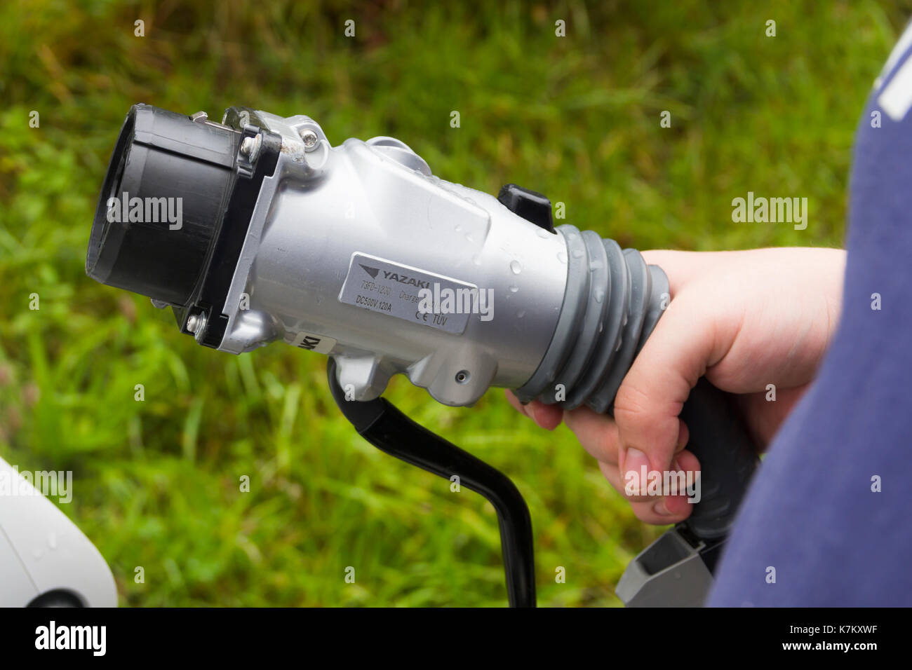 Charge coupler, manufactured by Yazaki, fitted to an Ecotricity electric car recharging point at Tebay services on the M6 in Cumbria - Stock Image