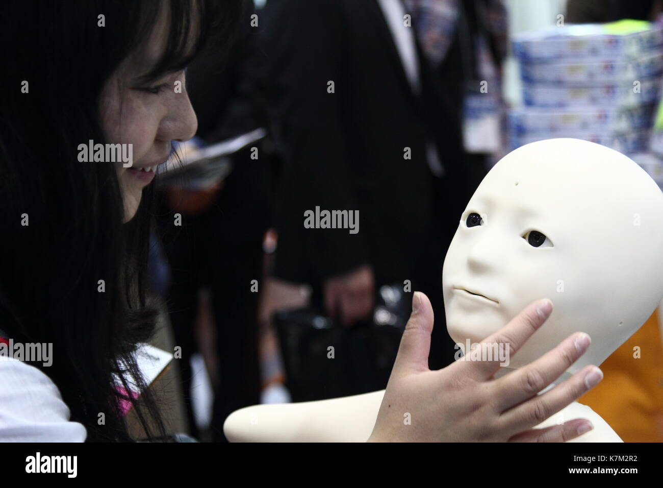 obsession in human - robot relationship - Stock Image