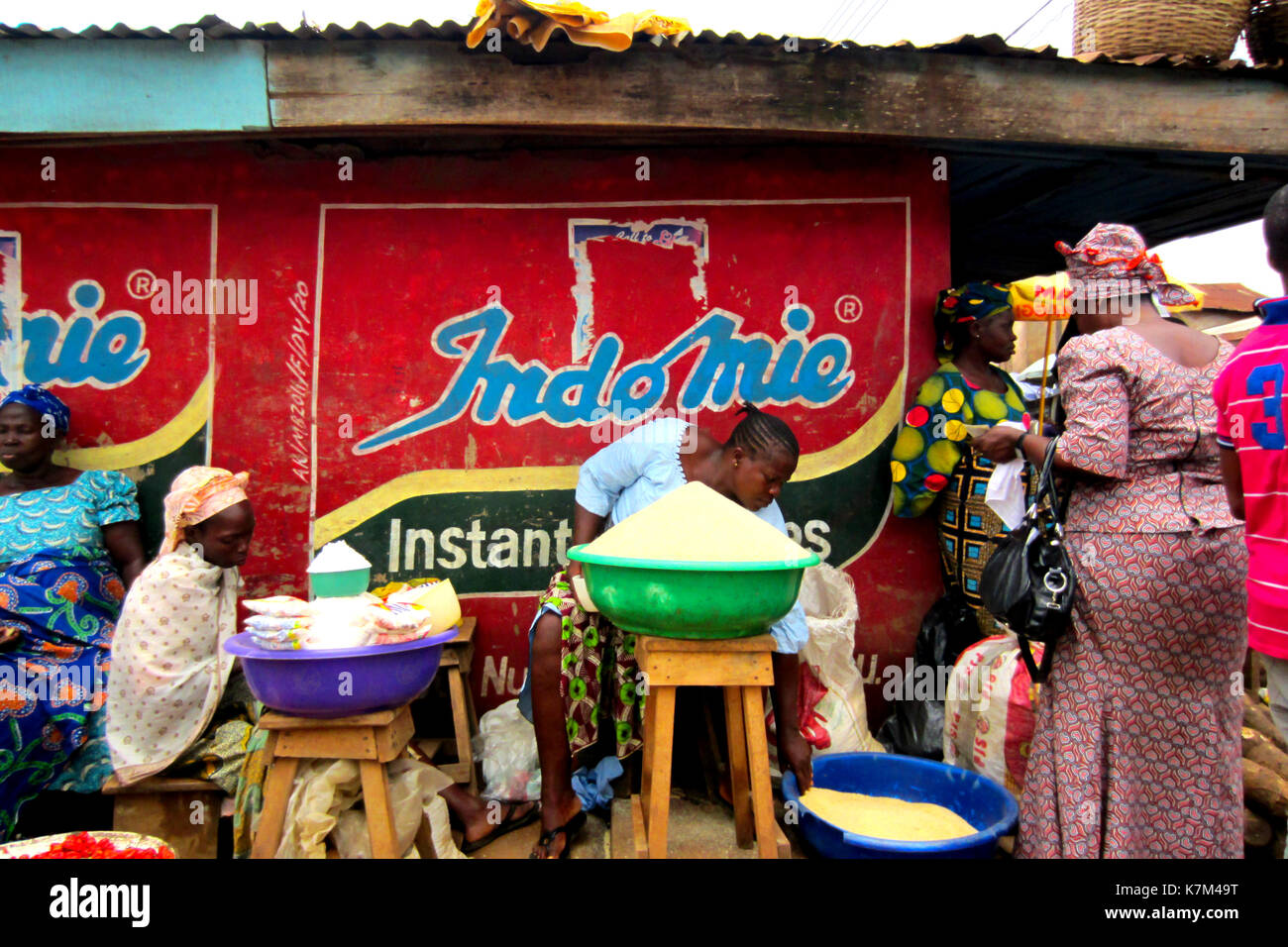 Women selling yam flour and different goods in the city of Lagos, Nigeria - Stock Image