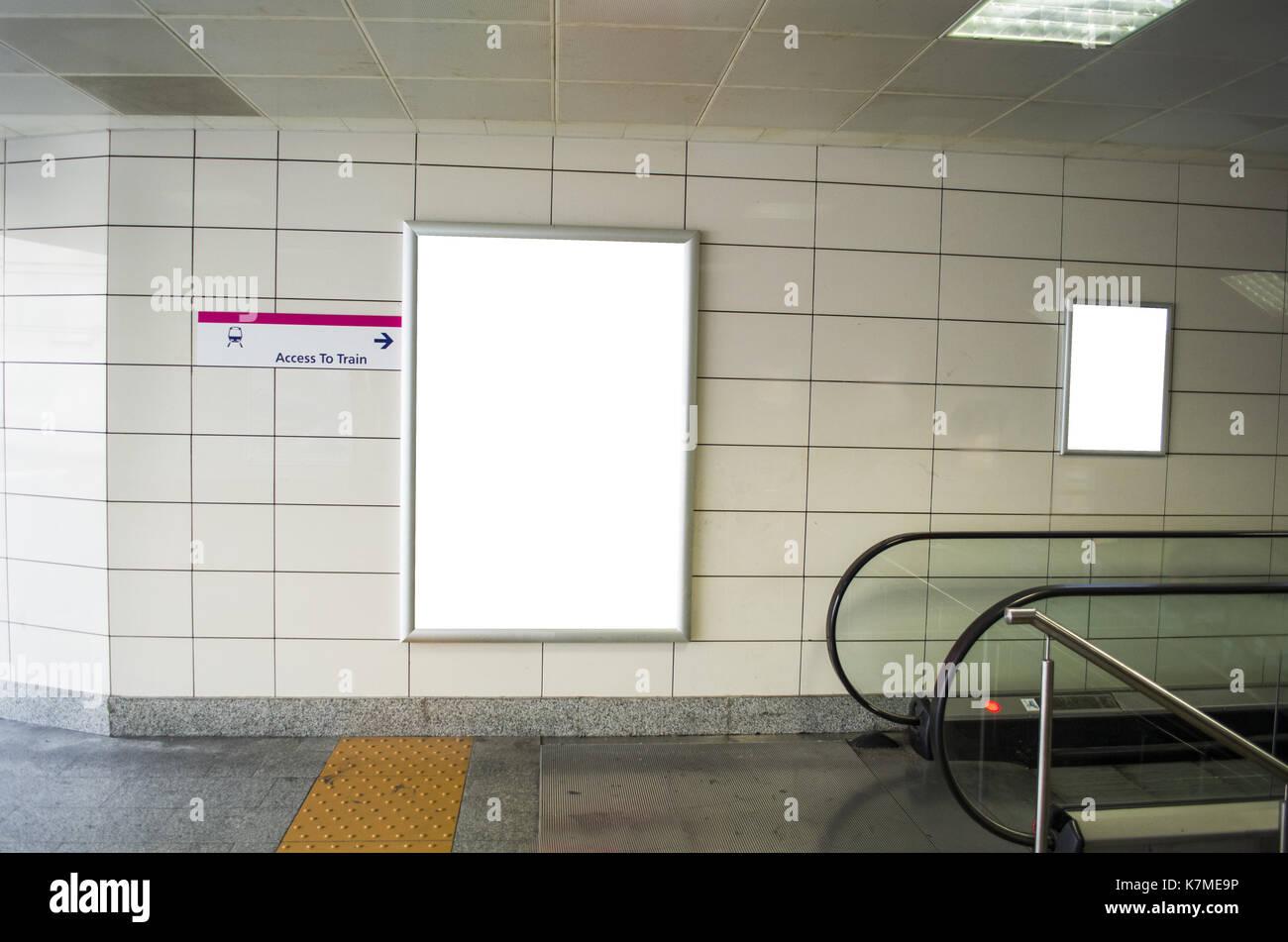 Blank billboard in subway station - Stock Image
