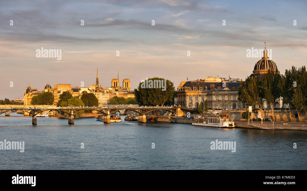 Sunset on the Seine River, Ile de la Cite and The French Institute in Summer. Paris, France - Stock Image