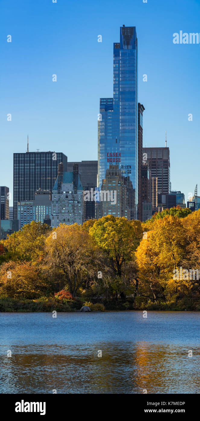 One57 skyscraper and the Central Park Lake in Fall. Manhattan, Midtown, New York City - Stock Image