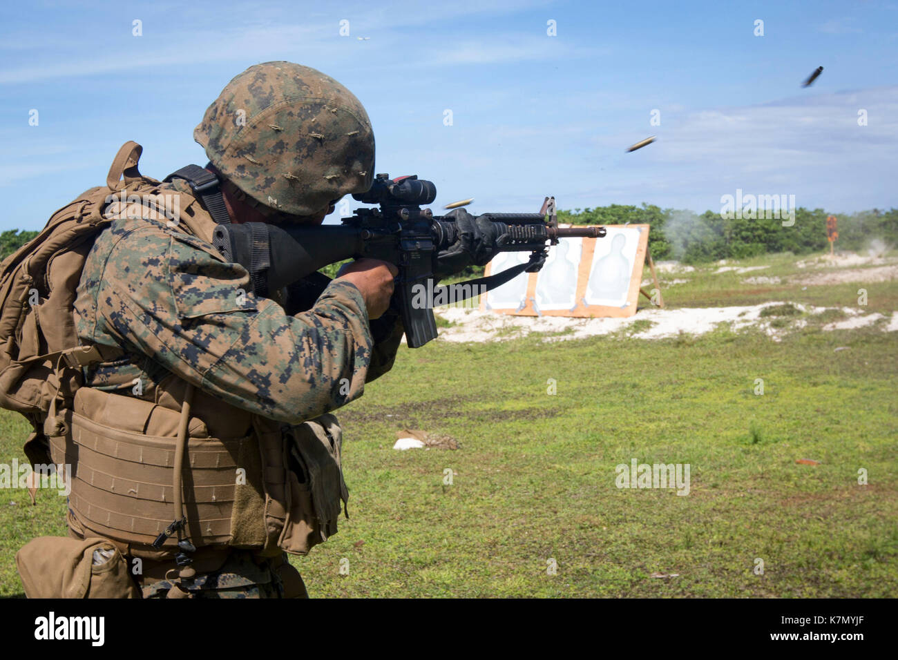 31st Marine Expeditionary Unit, fires an M16A4 service rifle Stock Photo