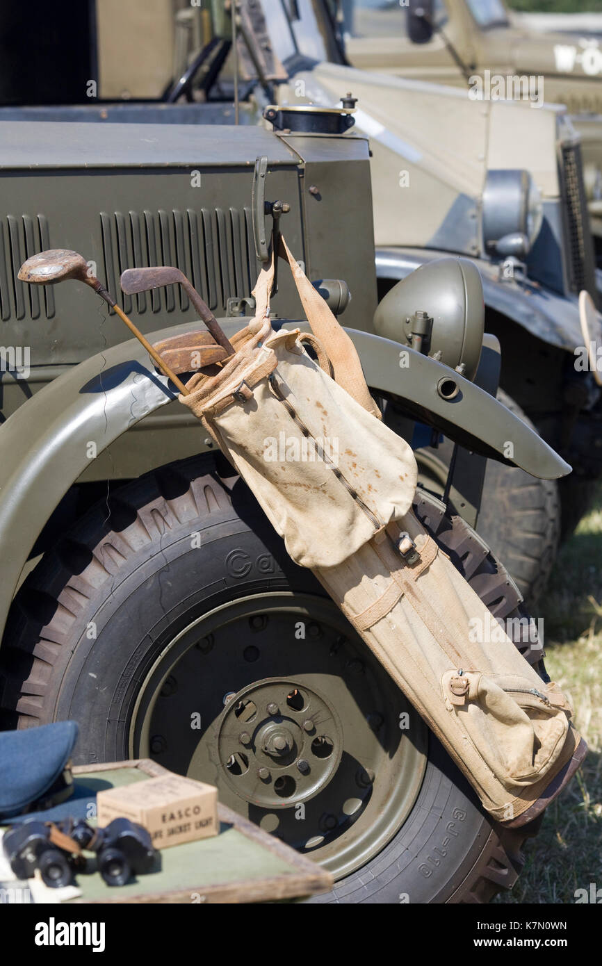 vintage golf clubs on a jeep - Stock Image