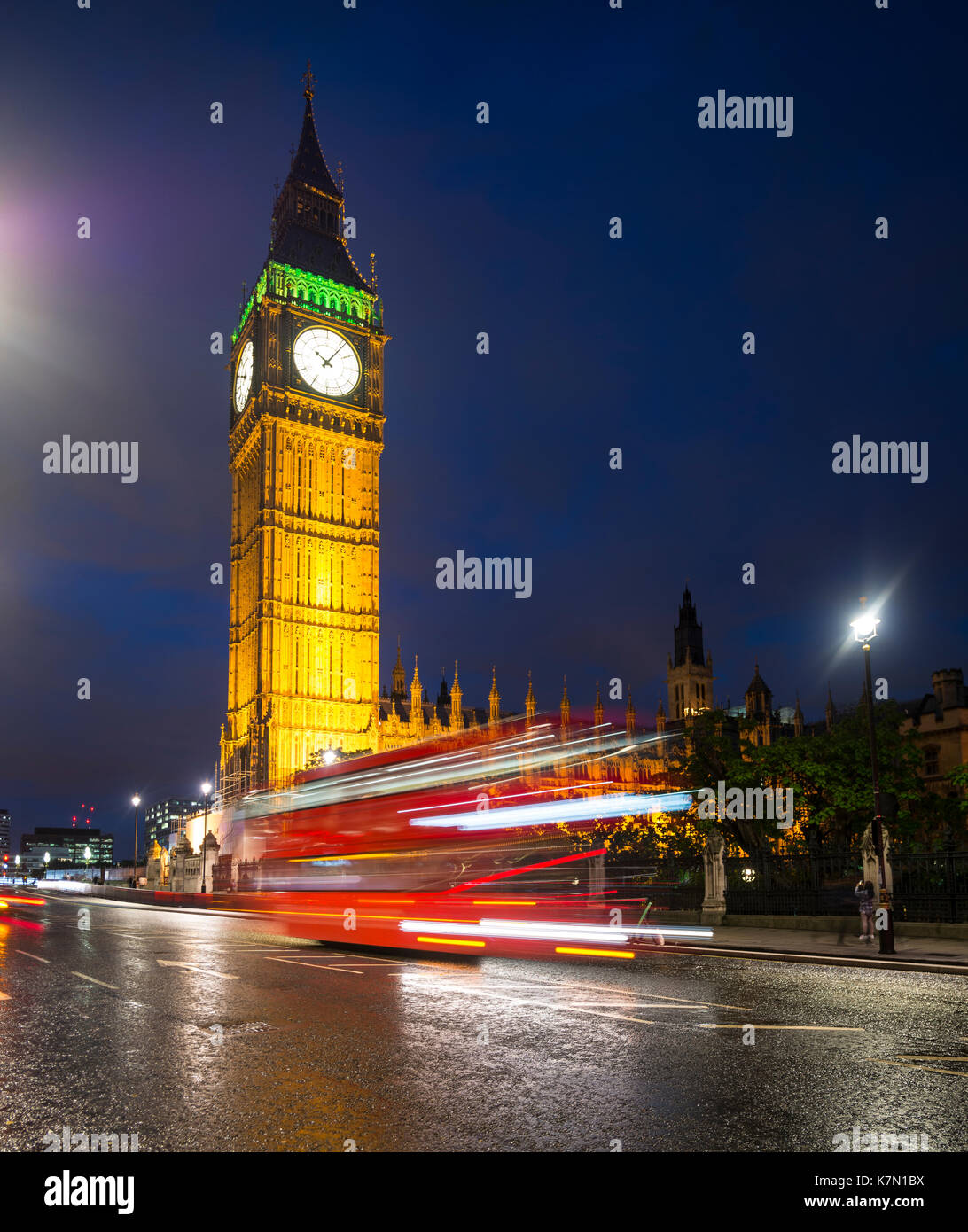 Red double-decker bus in front of Big Ben, Houses of Parliament, light tracks, night scene, City of Westminster, London - Stock Image